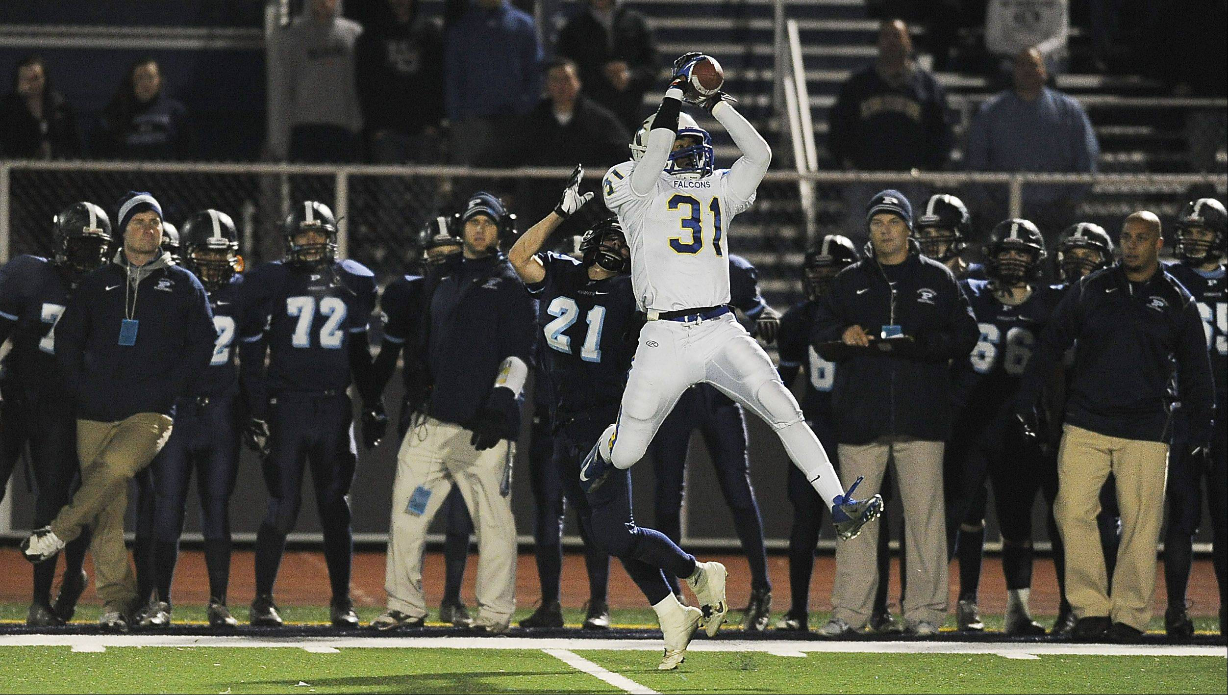 Wheaton North's Jaylen Howze in the fourth quarter intercepted this pass away from Prospect's Joe Gleason .