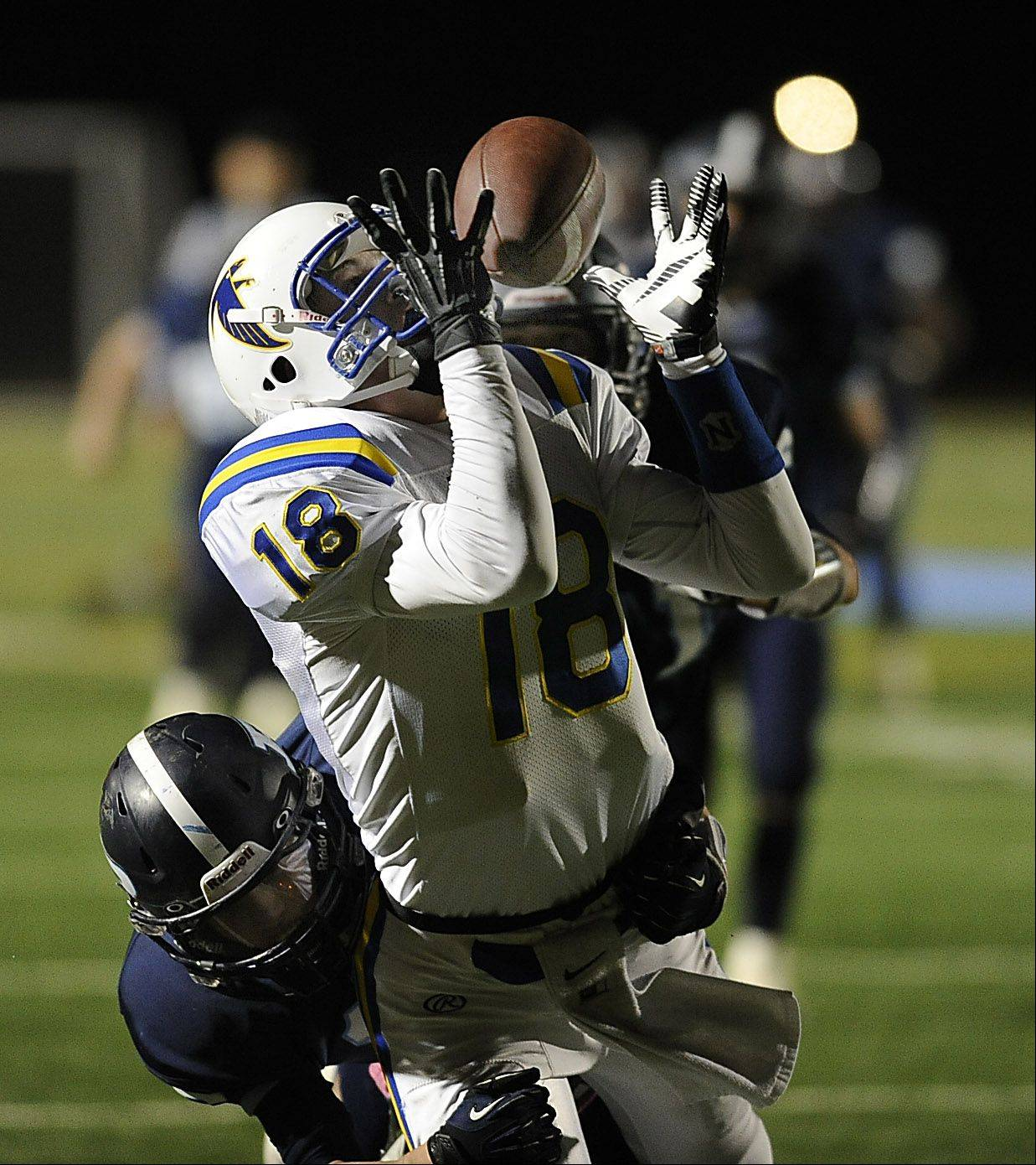 Prospect's defensive player Devin O'Hara applies pressure on Wheaton North's Clayton Thorson in the second quarter.