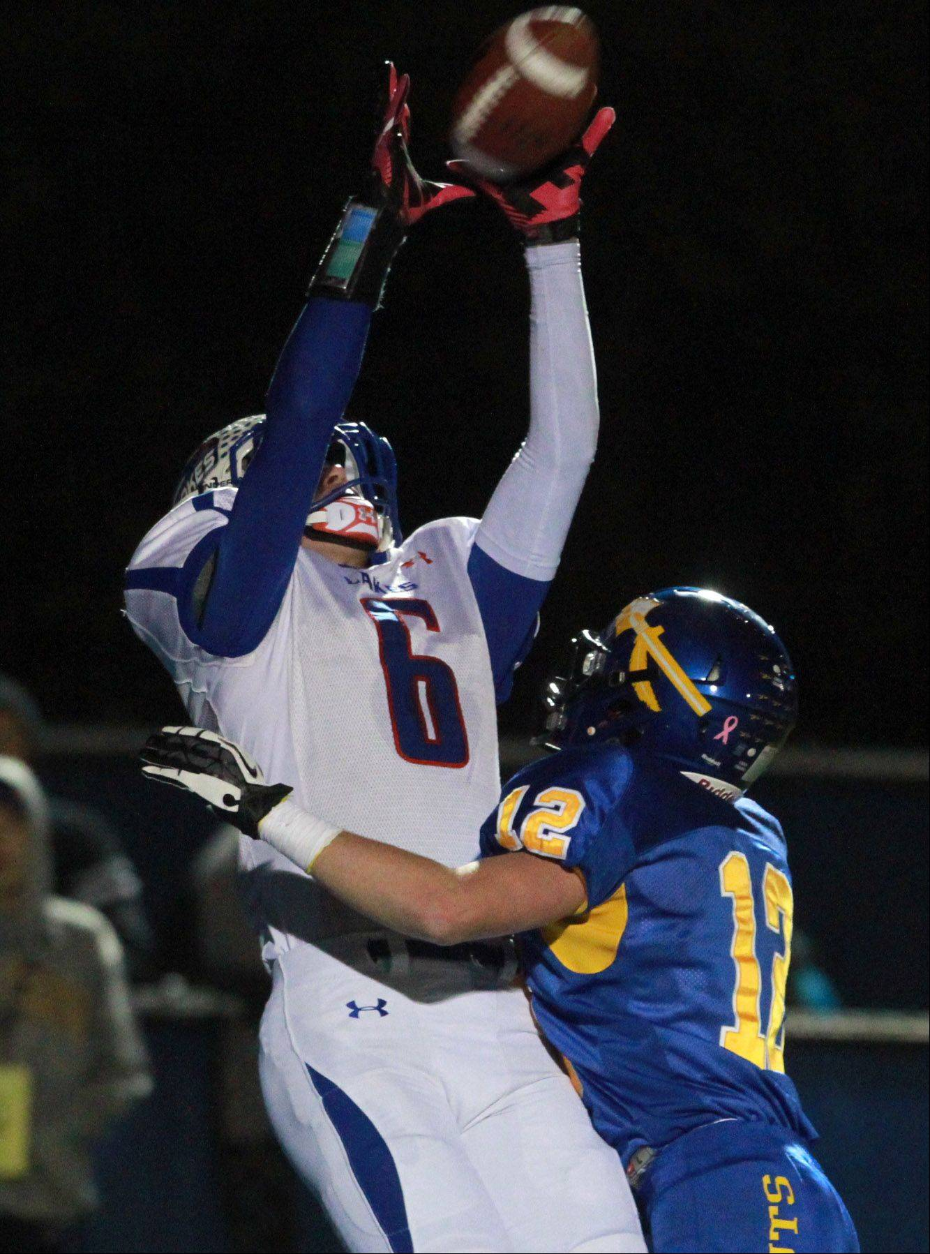 Lakes Justin Bergeron pulls in this pass for a touchdown in the first quarter.