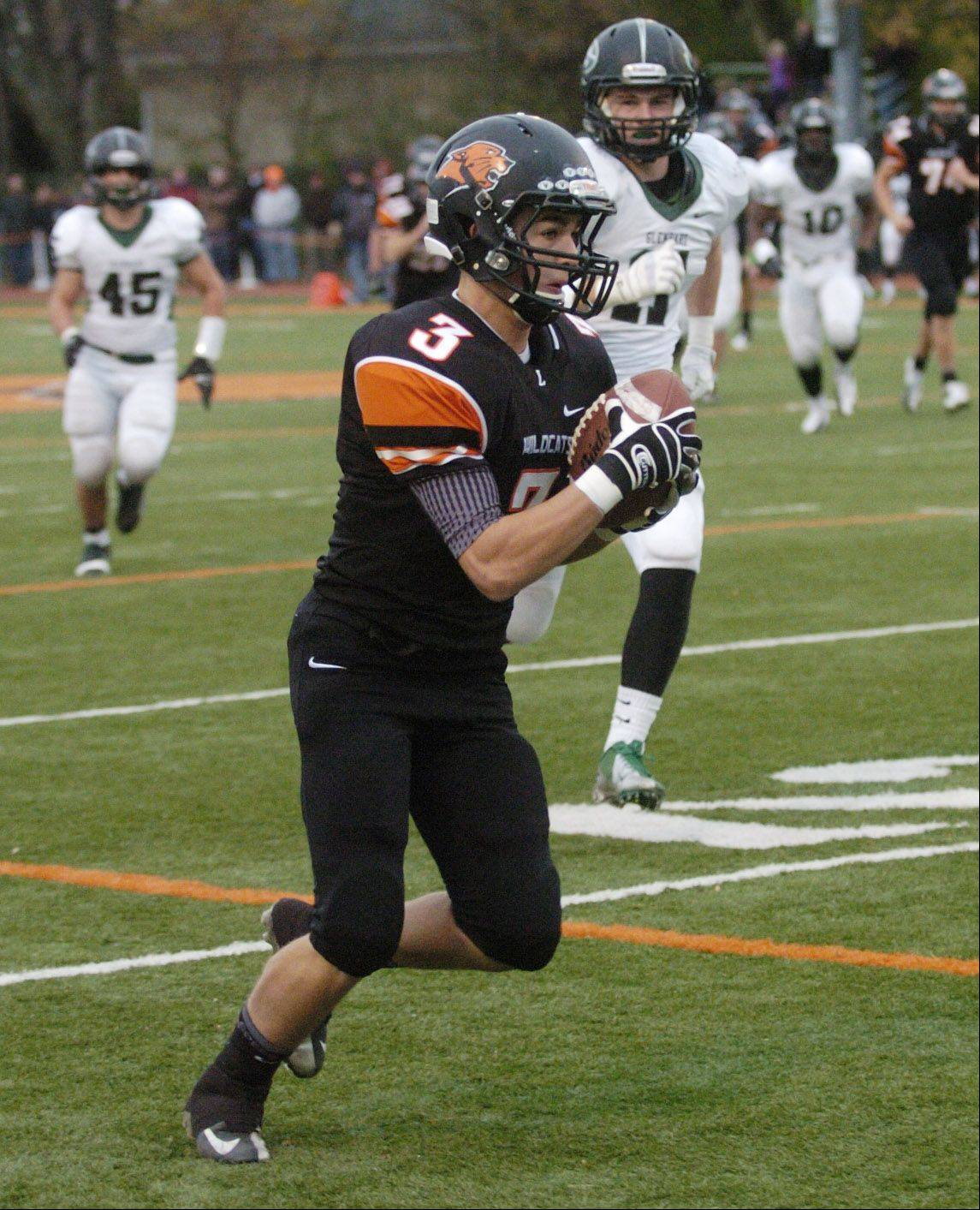 Libertyville's Justin Guarnaccio carries the ball for a touchdown on a pass play against Glenbard West Saturday.