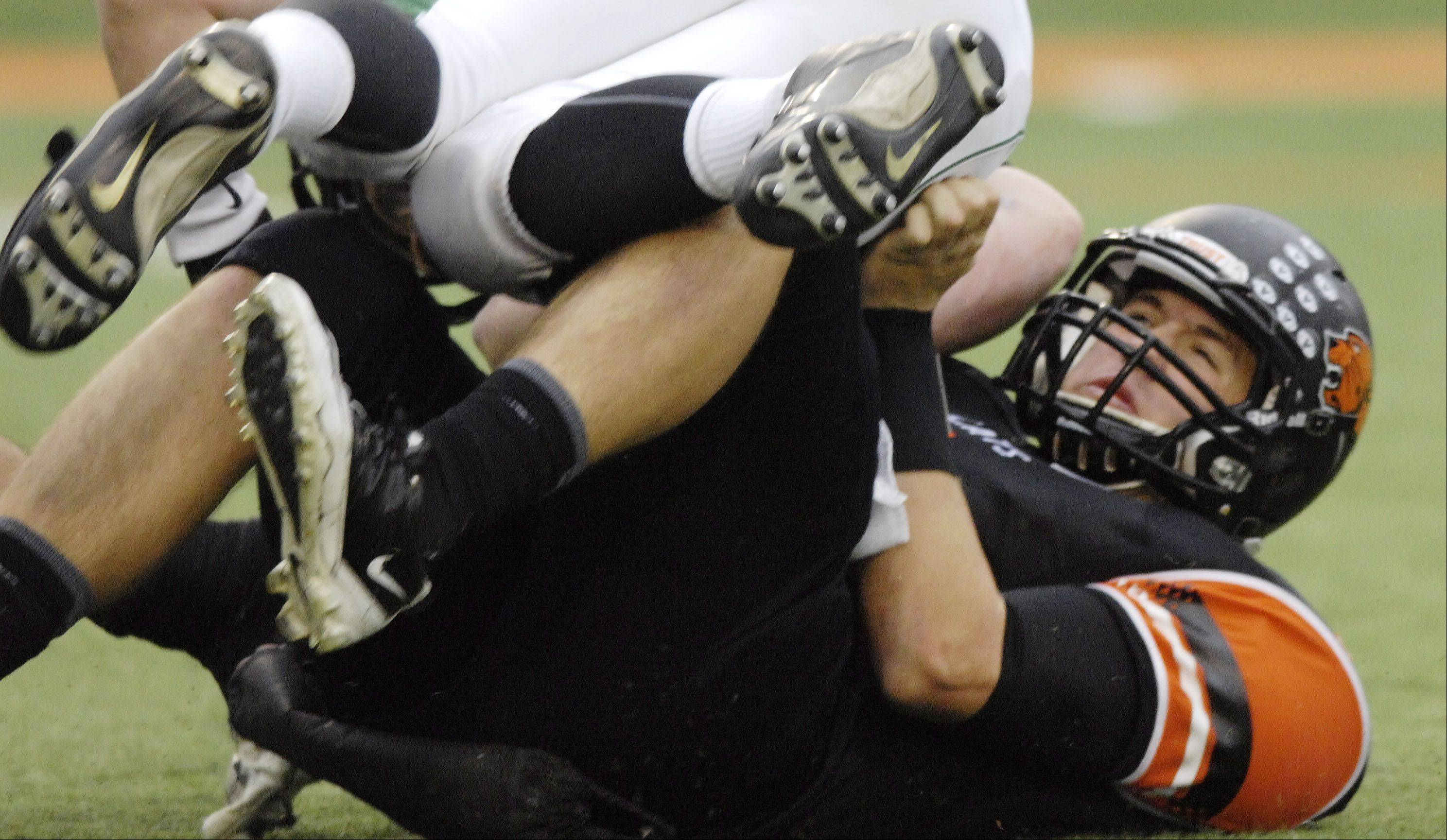 Libertyville quarterback Jack Deichl gets sacked during Saturday's game against Glenbard West.