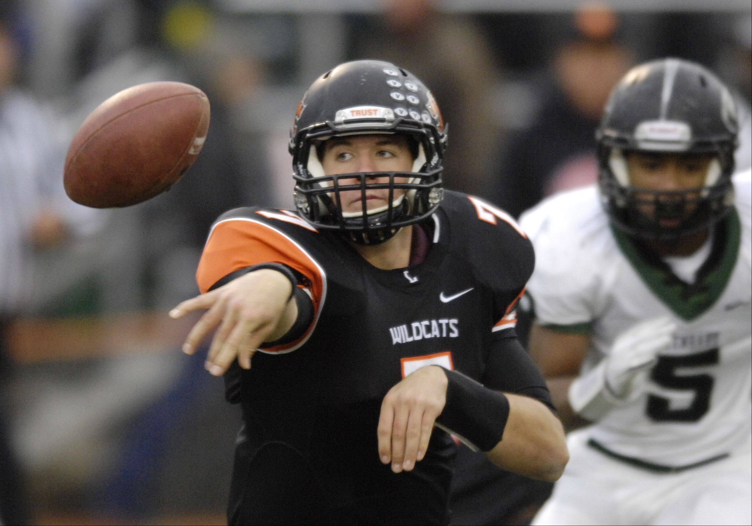 Libertyville quarterback Jack Deical makes a lateral during Saturday's game against Glenbard West.