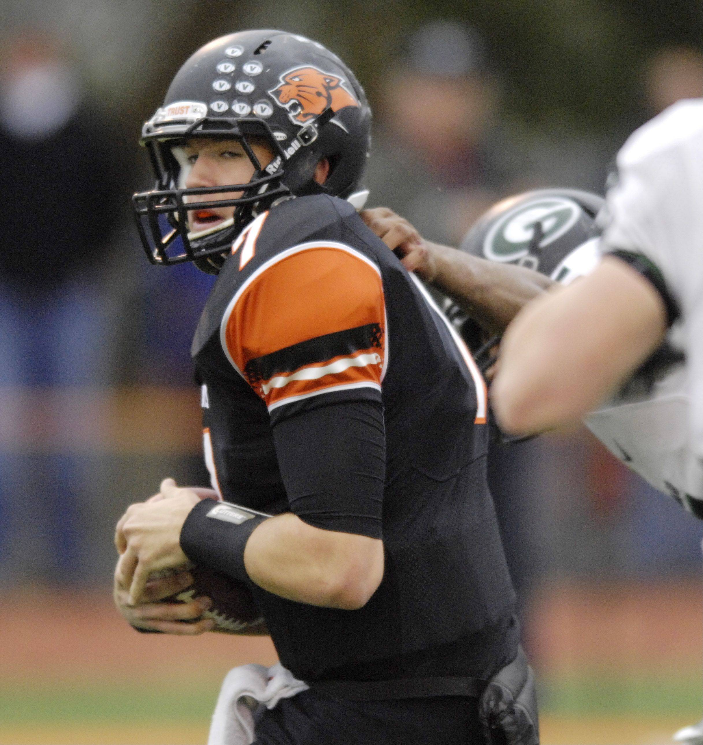 Libertyville quarterback Jack Deichl tries to avoid a sack during Saturday's game against Glenbard West.