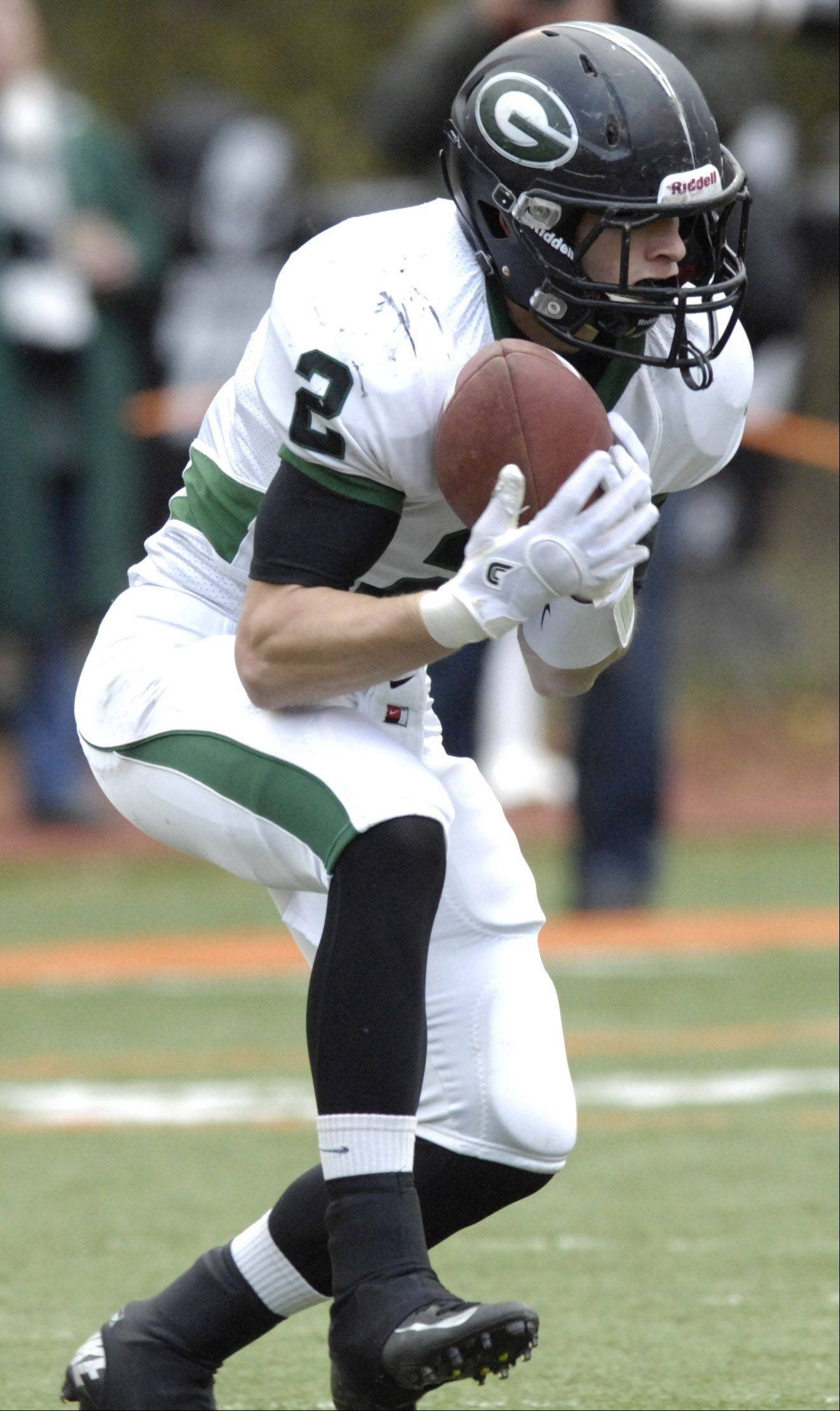 Glenbard West's Joe Marconi makes a first-quarter interception during Saturday's game against Libertyville.