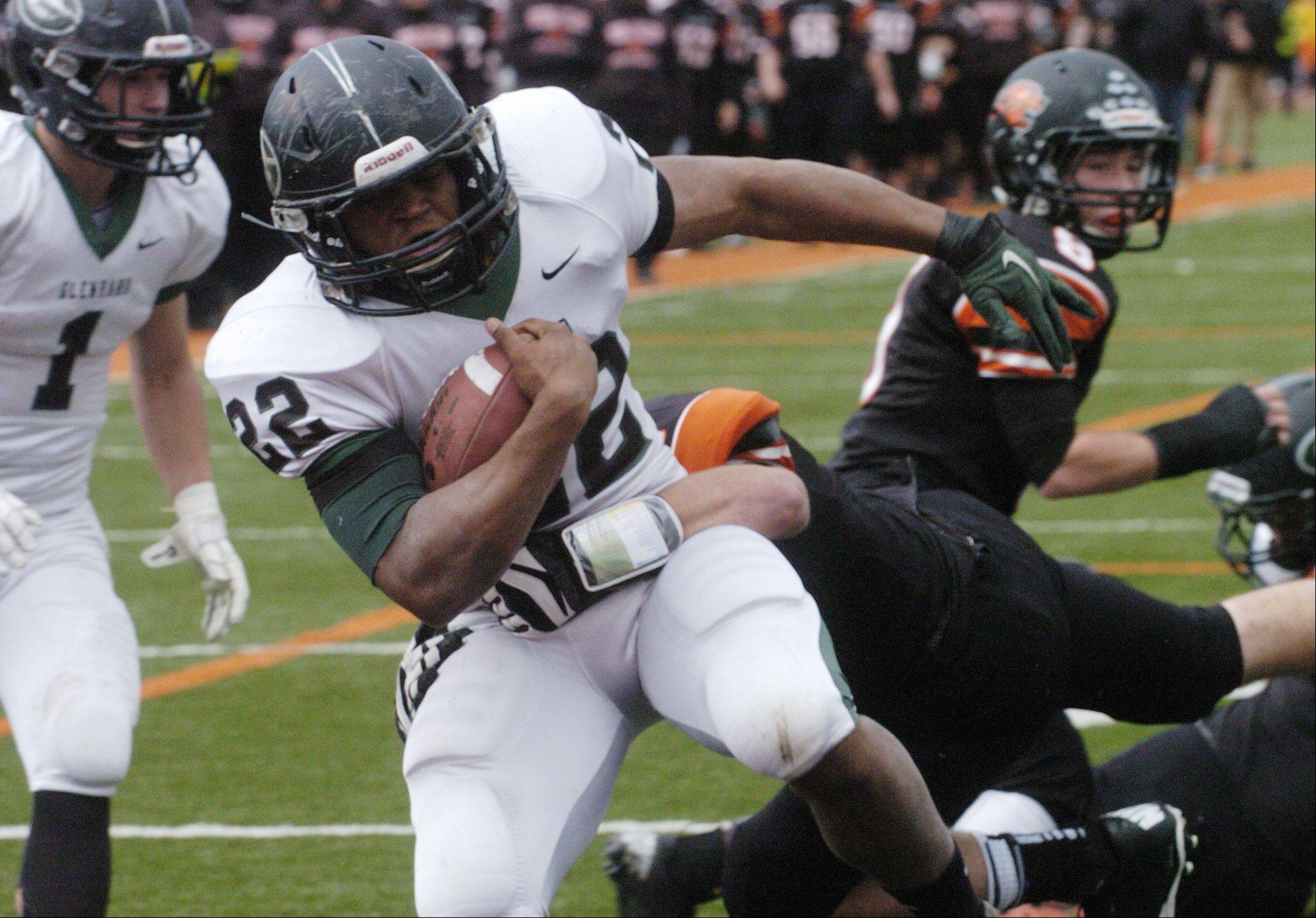 Glenbard West's Devante Toney carries the ball for a first-quarter touchdown against Libertyville Saturday.