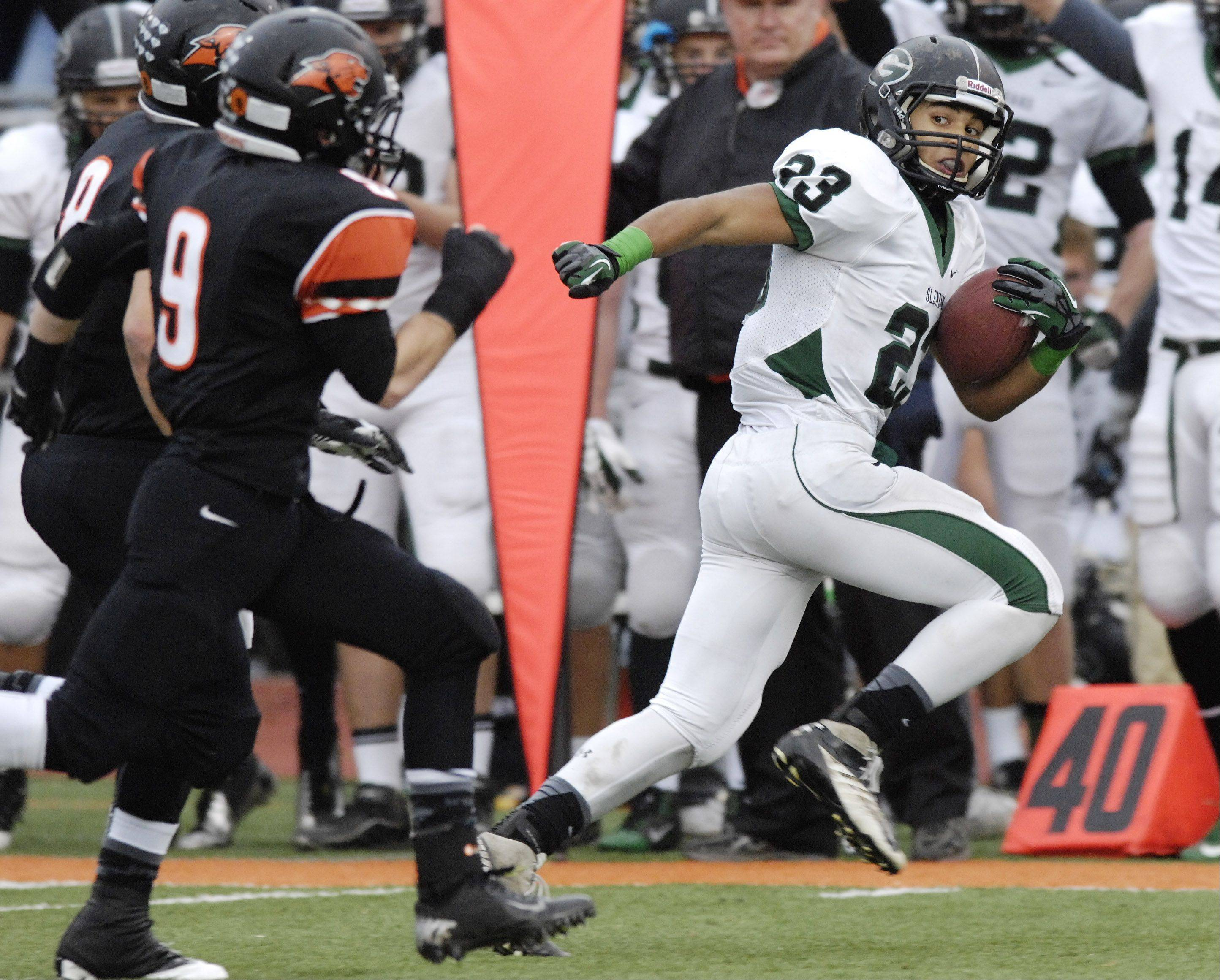 Glenbard West's Scott Andrews carries the ball during Saturday's game against Libertyville.