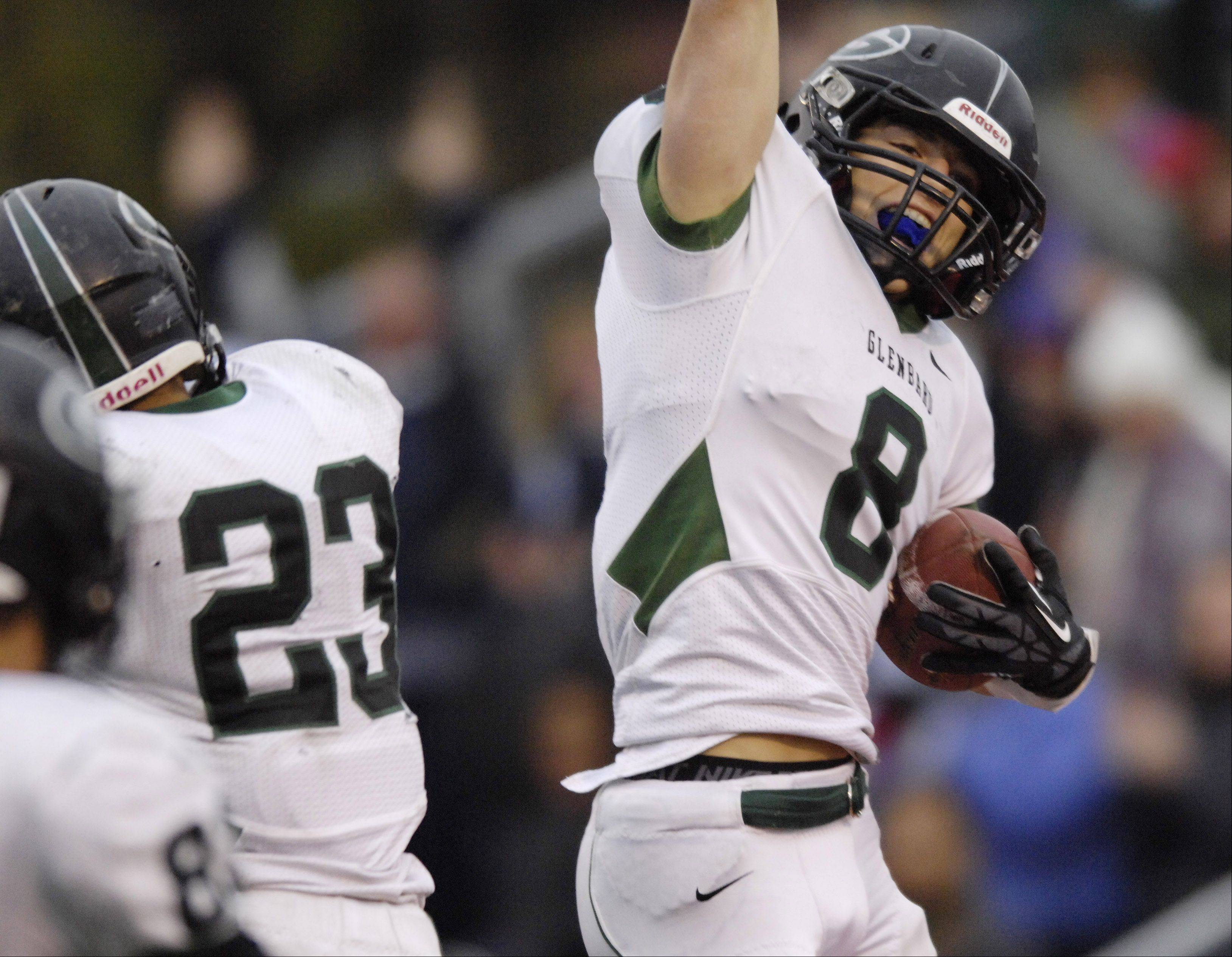 Glenbard West's Hayden Carlson celebrates a fourth-quarter touchdown against Libertyville Saturday.