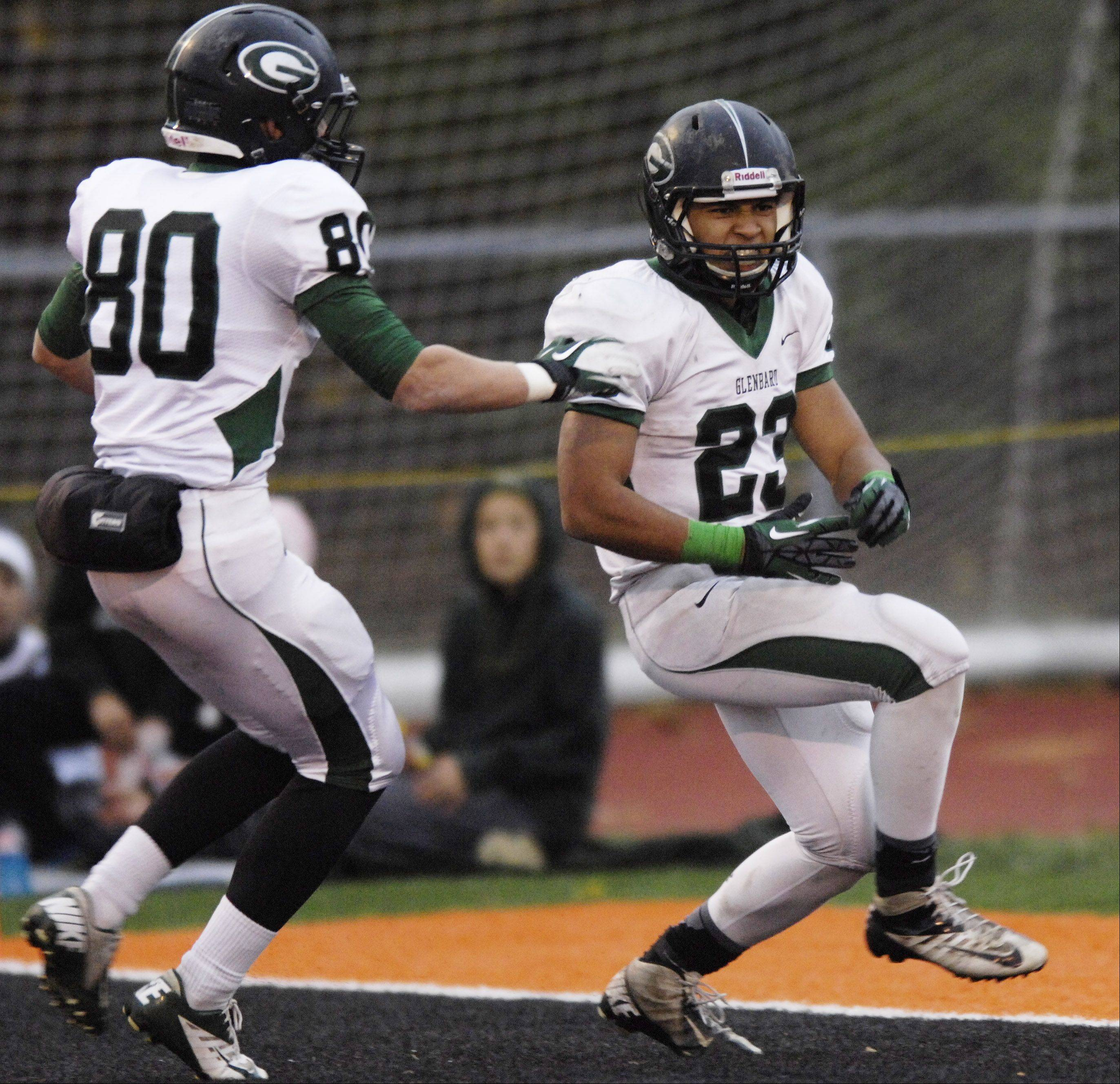 Glenbard West's Scott Andrews, right, celebrates his fourth-quarter touchdown with teammate Luke Domask Saturday against Libertyville.