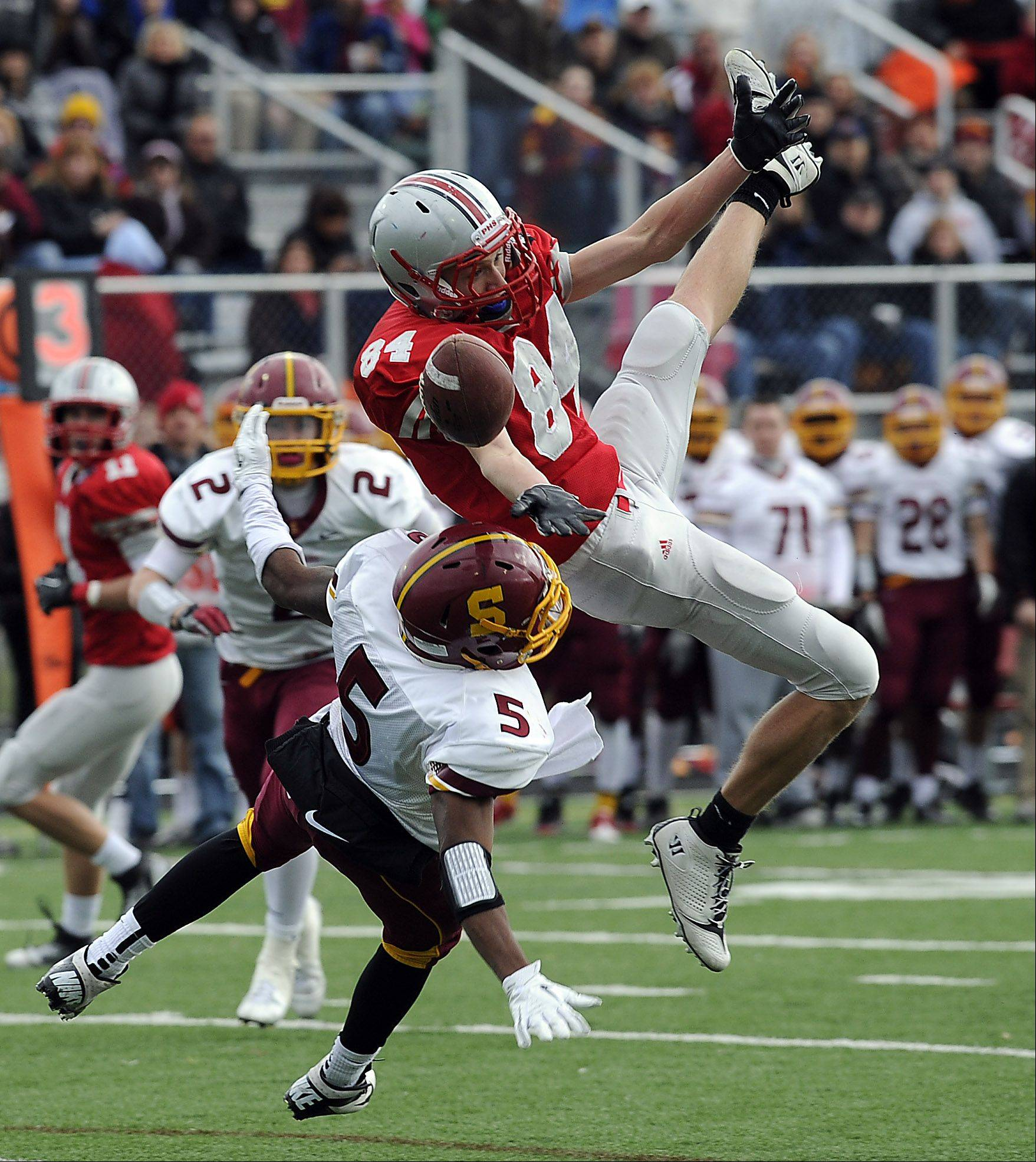 Palatine's Eric Theis has a first quarter pass play broken up by Schaumburg's Rahsaan Green Jr defensive coverage as Palatine advances to the third round of the Class 8A playoffs with their victory over Schaumburg at Palatine High School on Saturday.