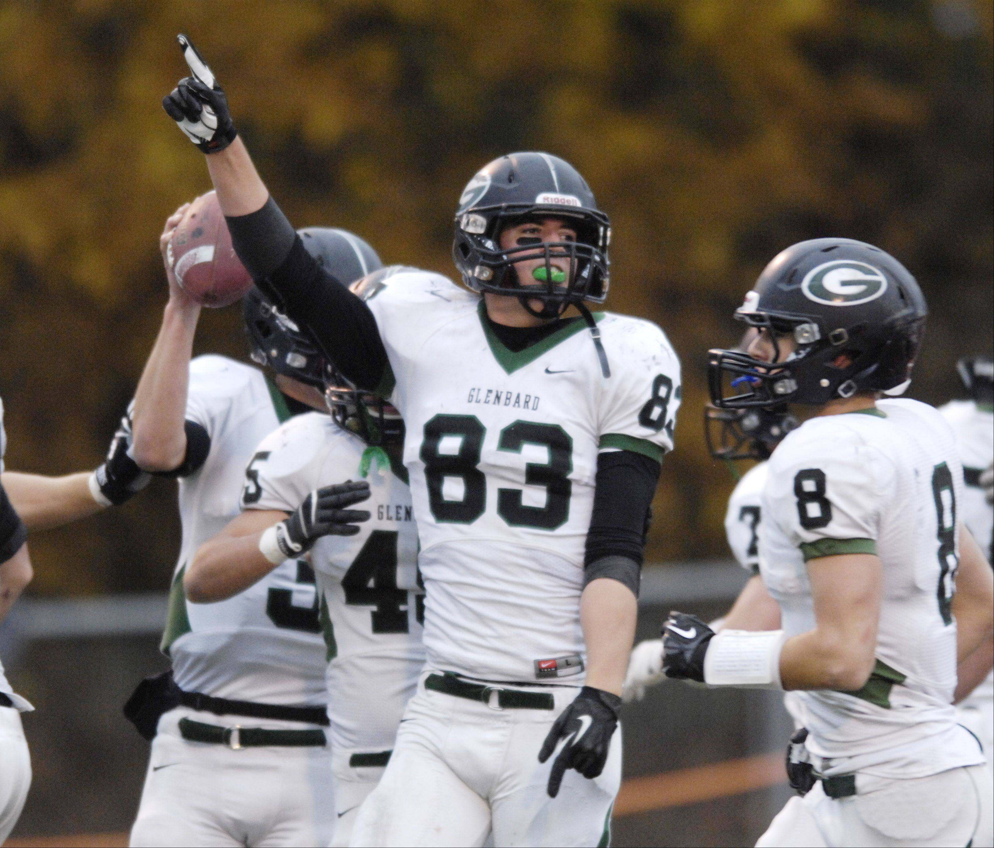 Glenbard West's Nathan Marcus celebrates a touchdown against Libertyville Saturday.