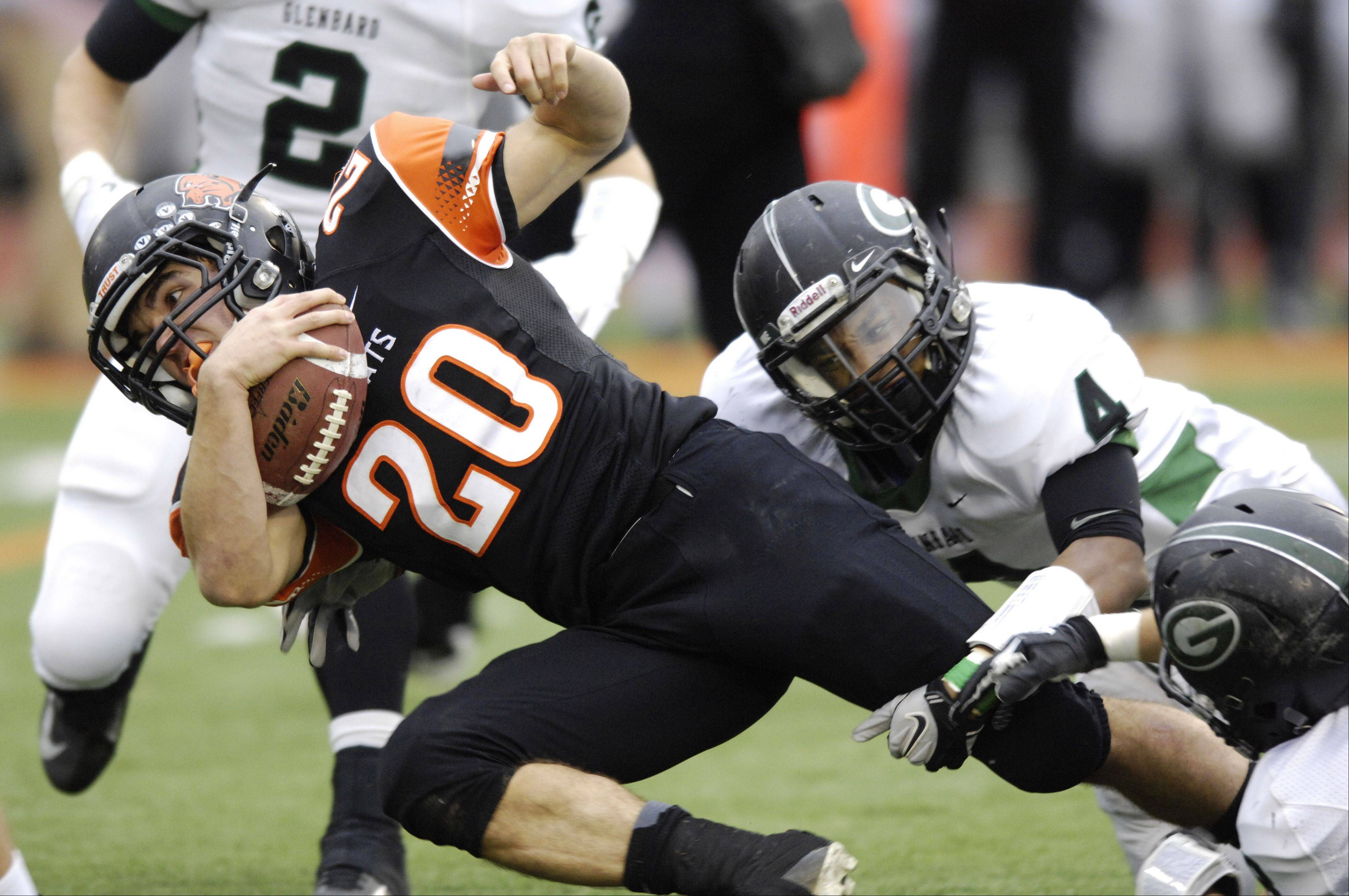 Libertyville running back Brian Swift gets tackled by Glenbard West's Keeshawn Matthews during Saturday's game.