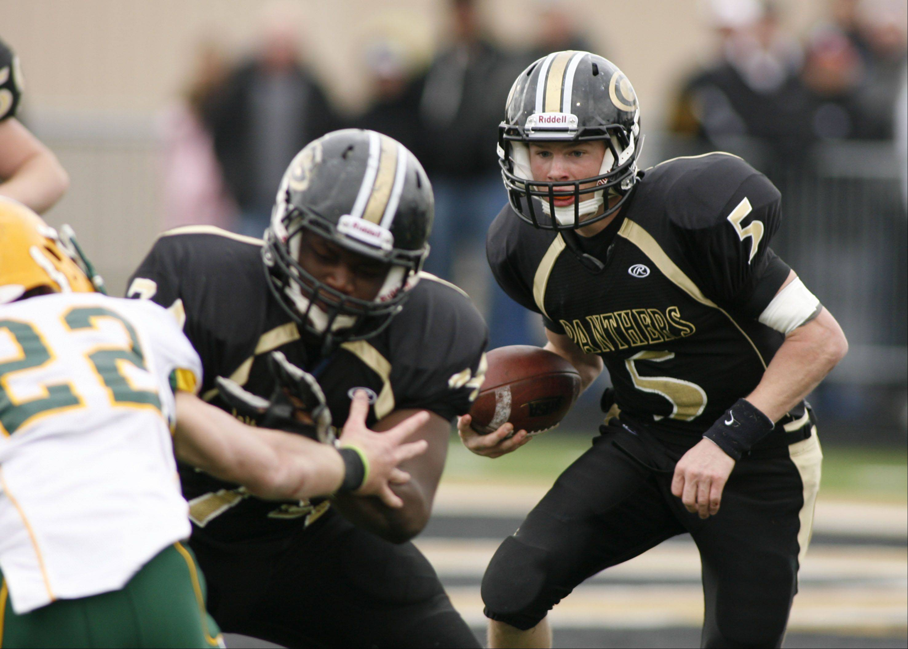 Glenbard North quarterback Brian Murphy follows his blocking against Stevenson, during second round Class 8A football playoffs.
