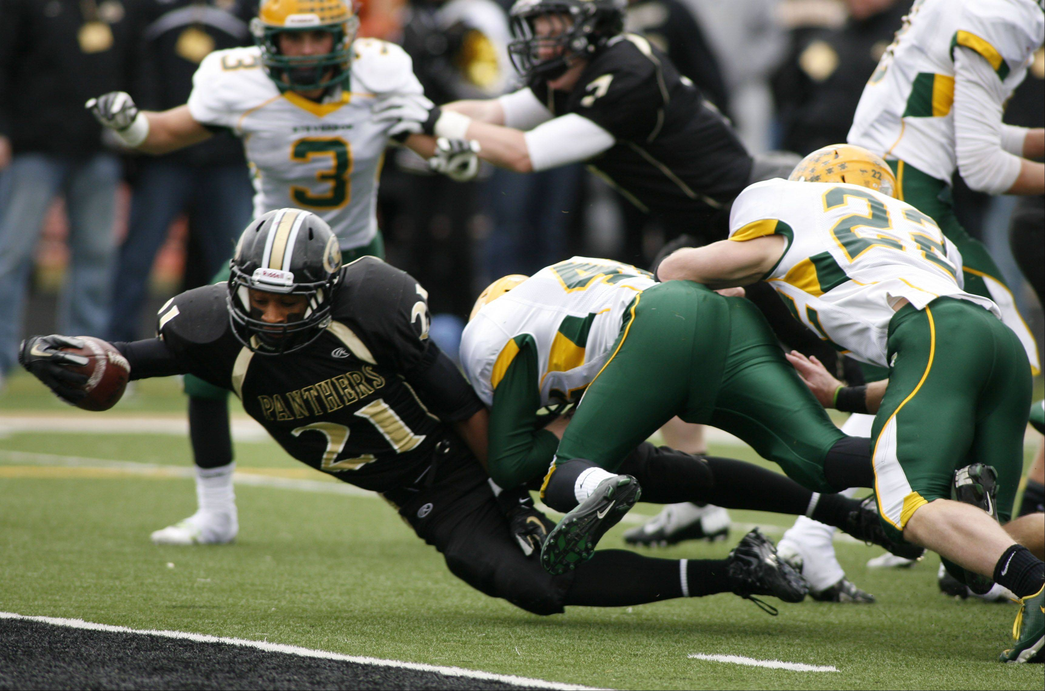 Glenbard North's Justin Jackson extends for a touchdown against Stevenson, during second round Class 8A football playoffs.