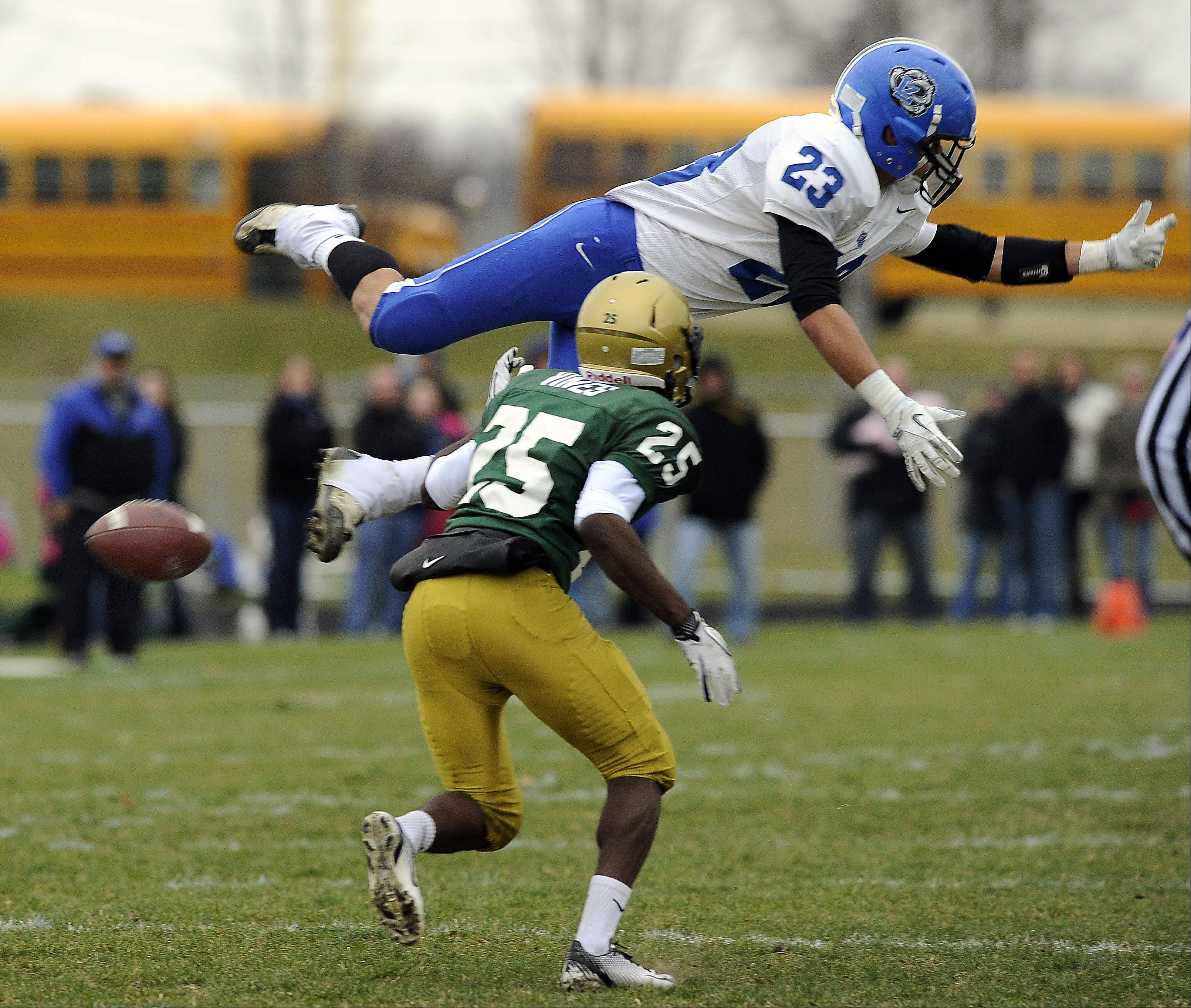 Lake Zurich's Grant Soucy soars over Rockford Boylan's DeMarcus Vines during the second quarter of the teams' Class 7A state semifinal matchup last season in Rockford. This year they're meeting in the quarterfinals, at 1 p.m. Saturday at Lake Zurich, with both Soucy and Vines again key players for their teams.