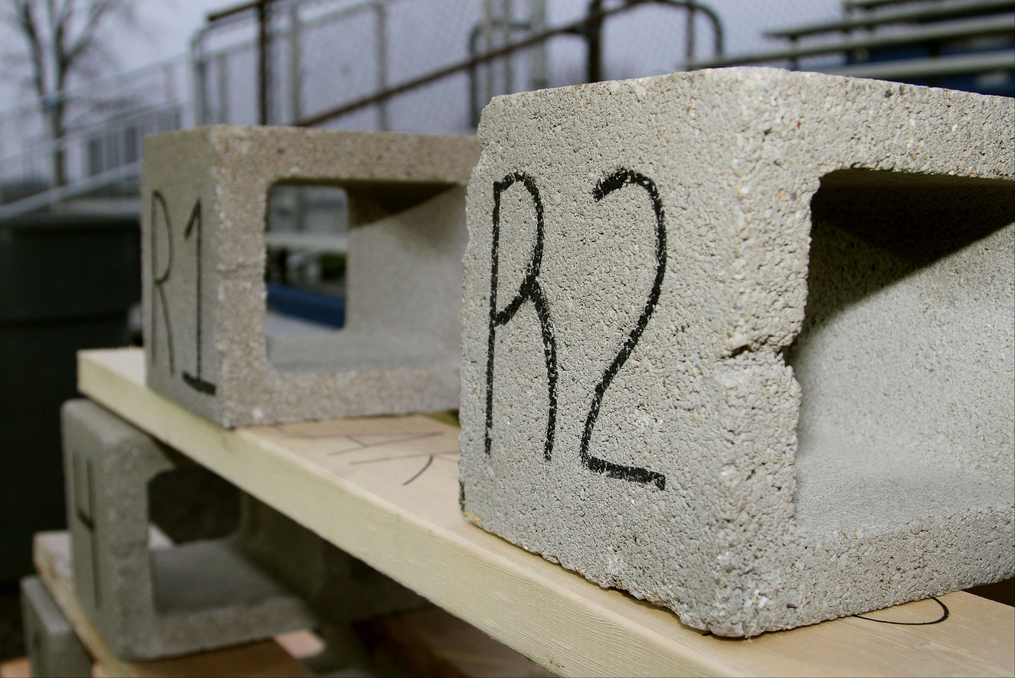A cinder block structure resides in the North end zone of the Lake Zurich football stadium. Goals are written on the blocks as well as on the boards that hold them up. At the end of the season, all of the players' bricks get placed between the cinder blocks. The tradition began the year LZ won state, in 2007.