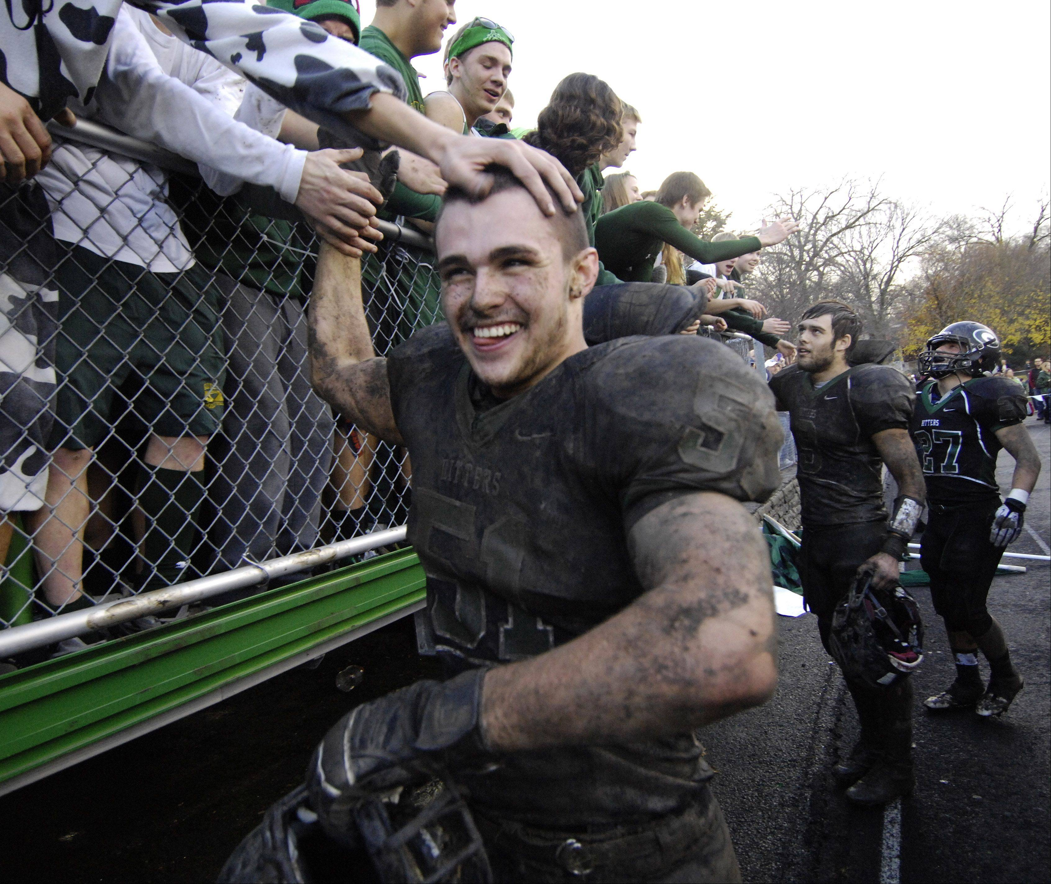 Glenbard West's Nick Garland receives congratulations from fans following Saturday's 3-0 victory over Wheaton North.