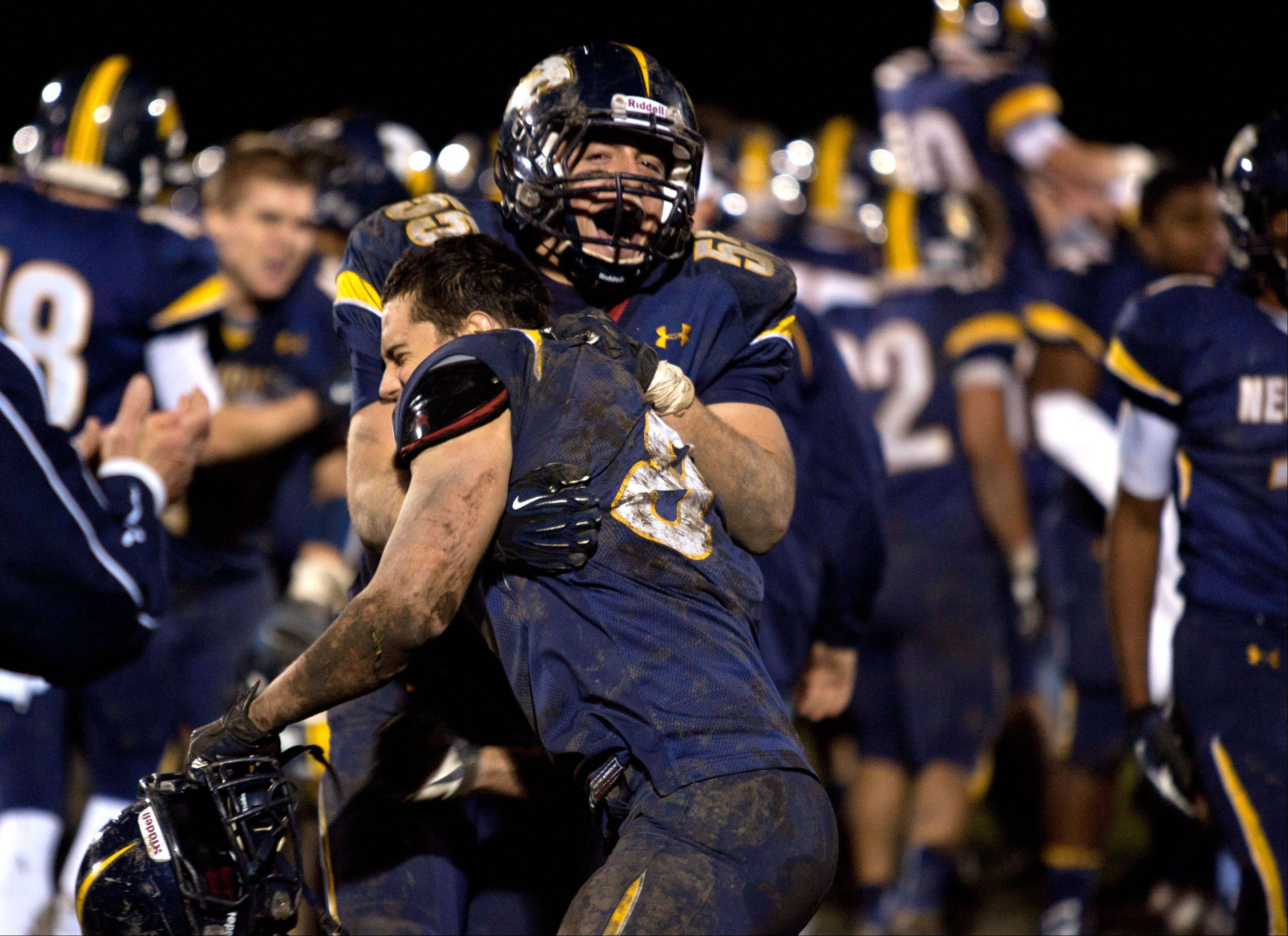 Neuqua Valley's Michael Casas, 55, and John Moore, 8, celebrate Saturday's win over Waubonsie Valley.