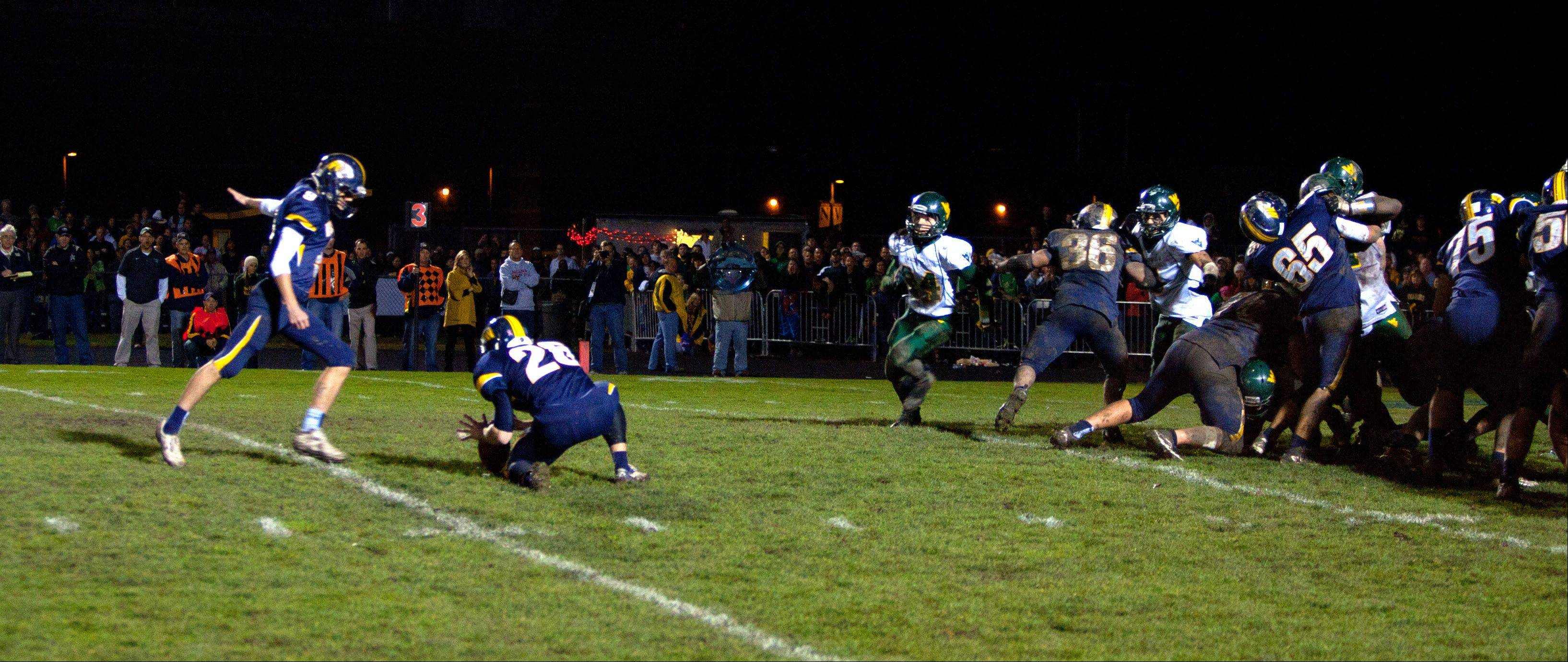 With seconds remaining, Neuqua Valley's Ryan Mulhern kicks the game winning field goal against Waubonsie Valley.