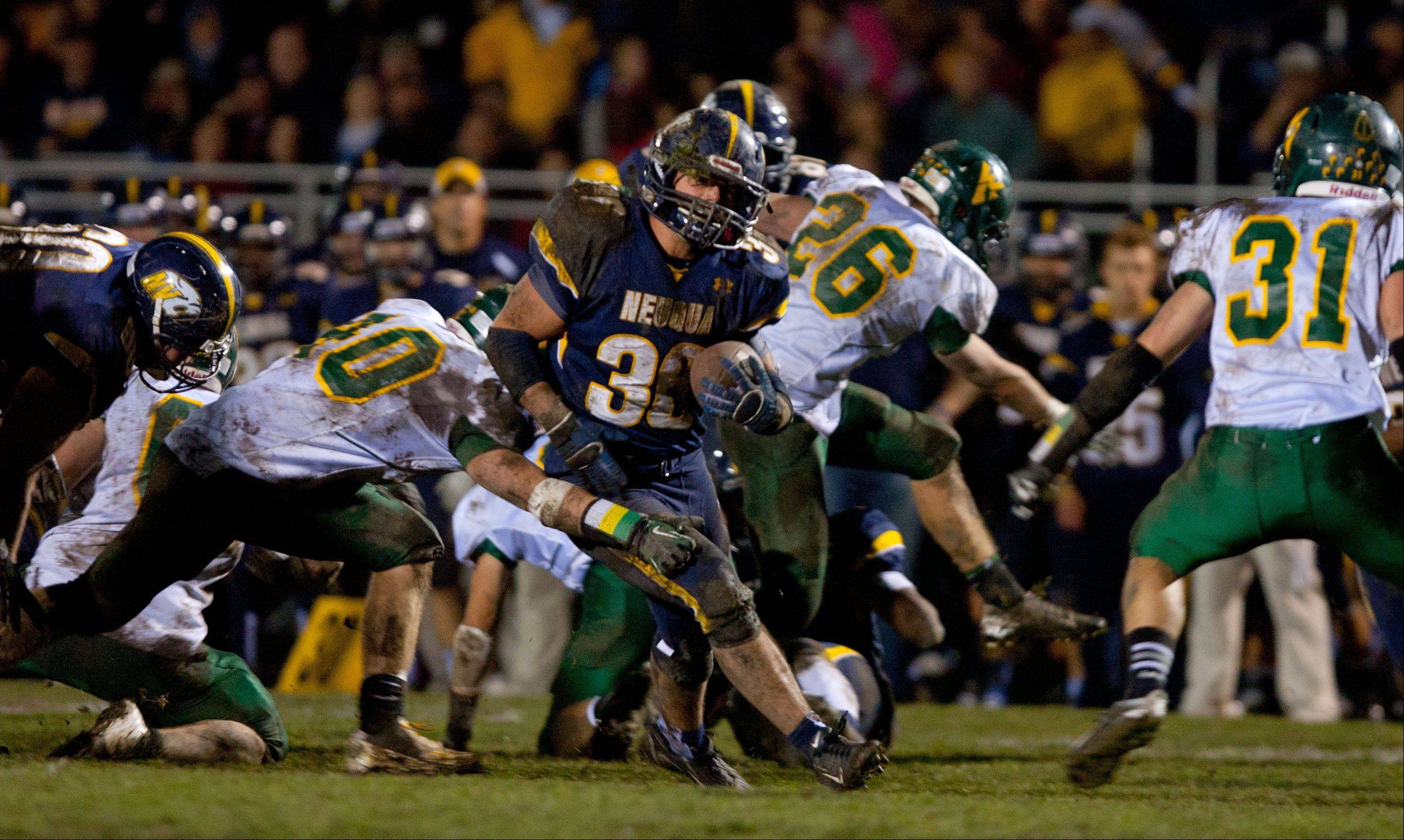Neuqua Valley's Joey Rhattigan, 36, blasts through the Waubonsie Valley defense scoring his second of three touchdowns.