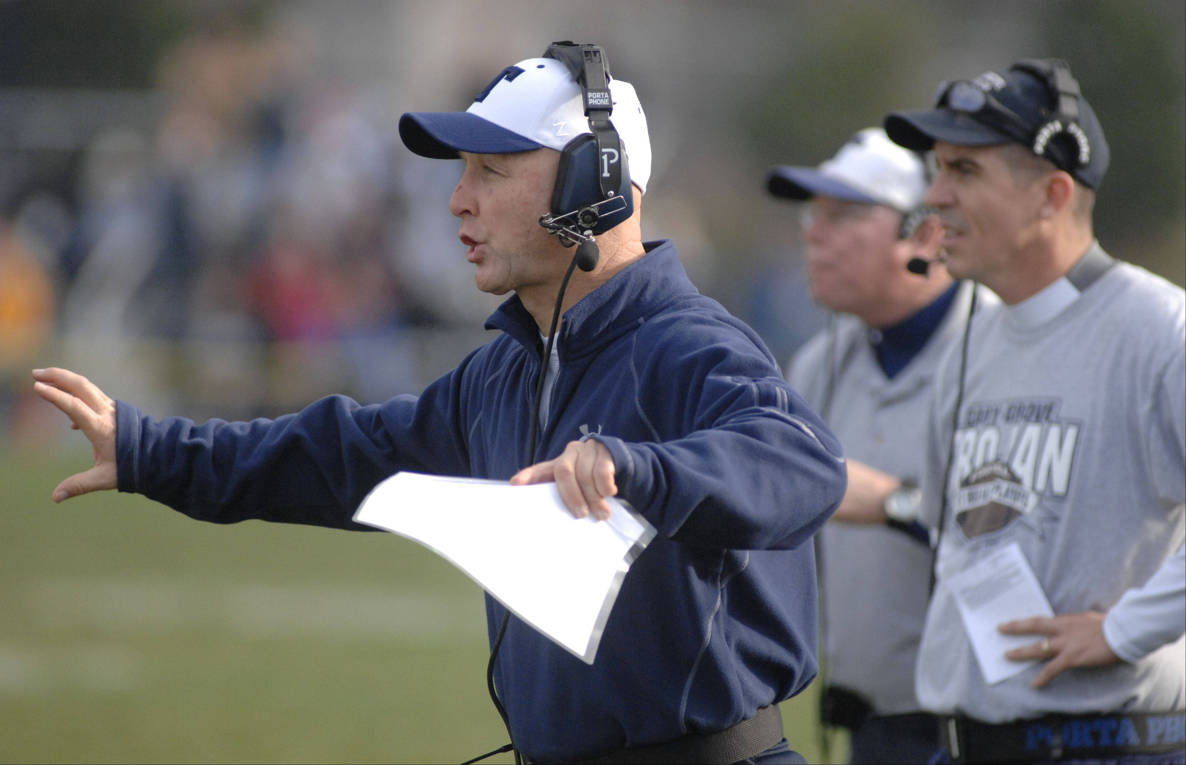 Cary-Grove defensive coordinator Don Sutherland directs his troops during the Trojans' 7-0 Class 6A quarterfinal win over Crystal Lake Central Saturday.
