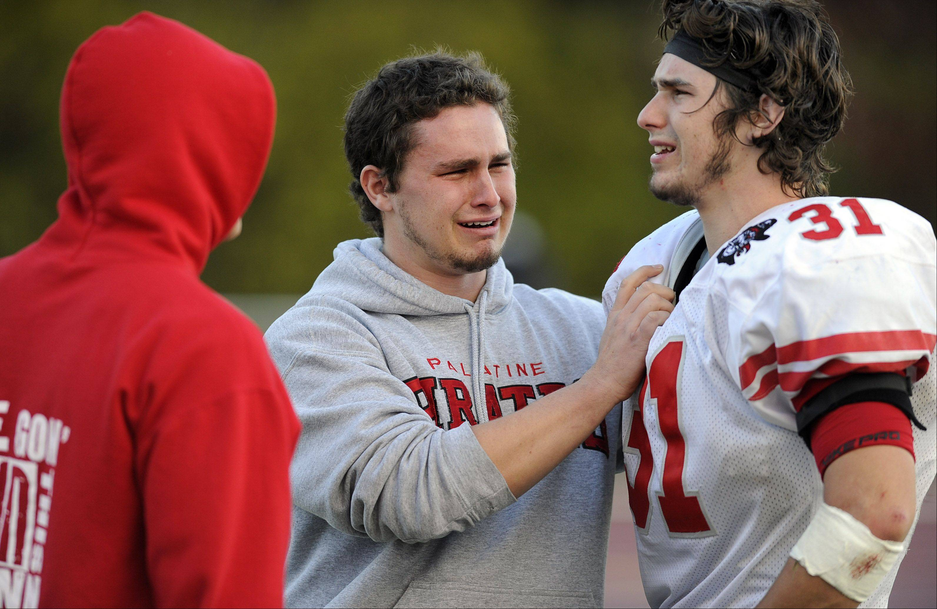 Palatine's Jesse Bobbit and his brother react after losing to Loyola.