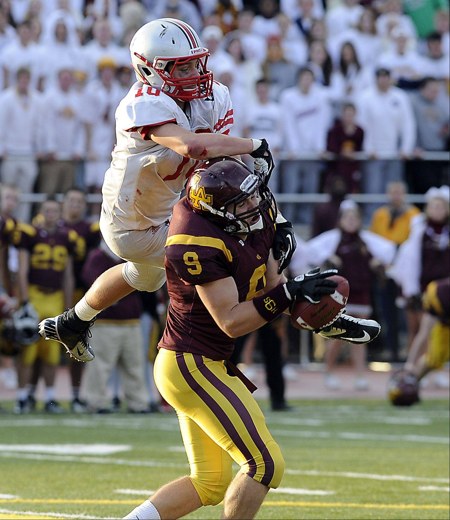 Palatine's Cam Kuksa loses the ball on a fourth quarter interception by Loyola's Cody Sullivan.