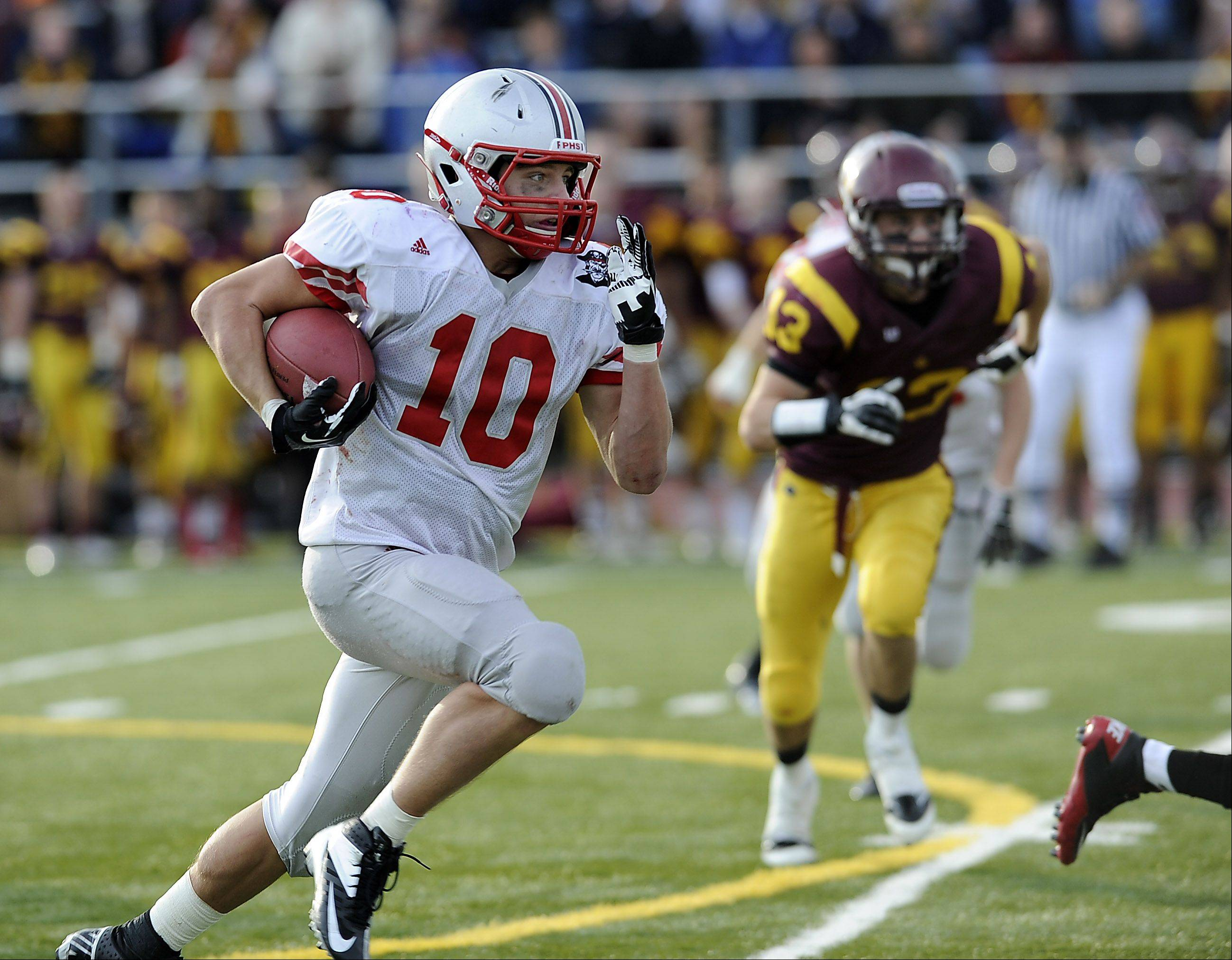 Palatine's Cam Kuksa runs back a kick-off return for a touchdown in the third quarter.