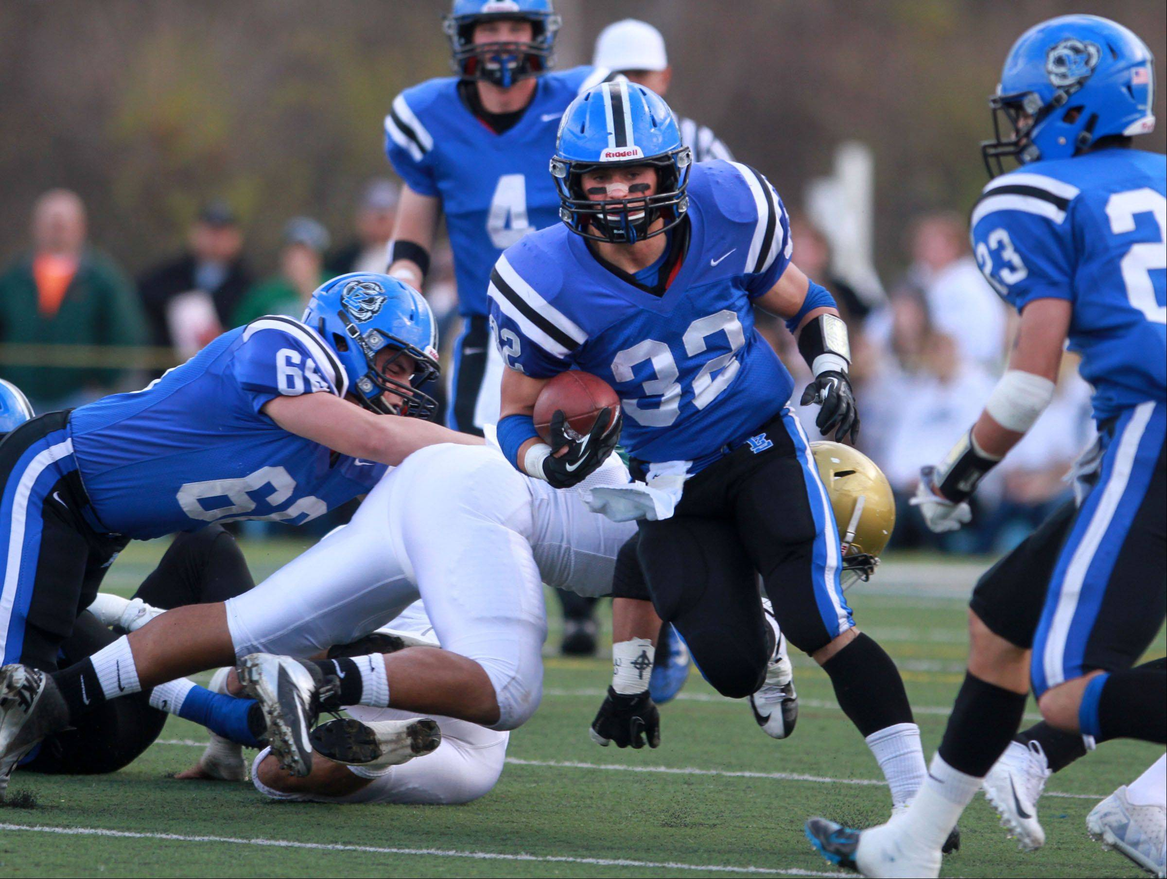 Lake Zurich running-back Connor Schrader breaks through a hole against Rockford Boylan as Lake Zurich wins the Class 7A state quarterfinal game at home on Saturday.