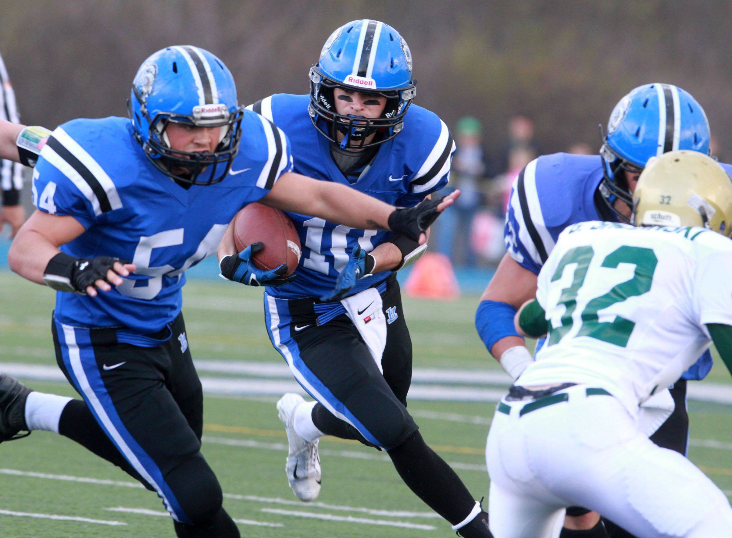 Lake Zurich's Jake Stauner get blocking from lineman Aaron Hussey as he runs the ball against Rockford Boylan in Class 7A state quarterfinal at Lake Zurich on Saturday.