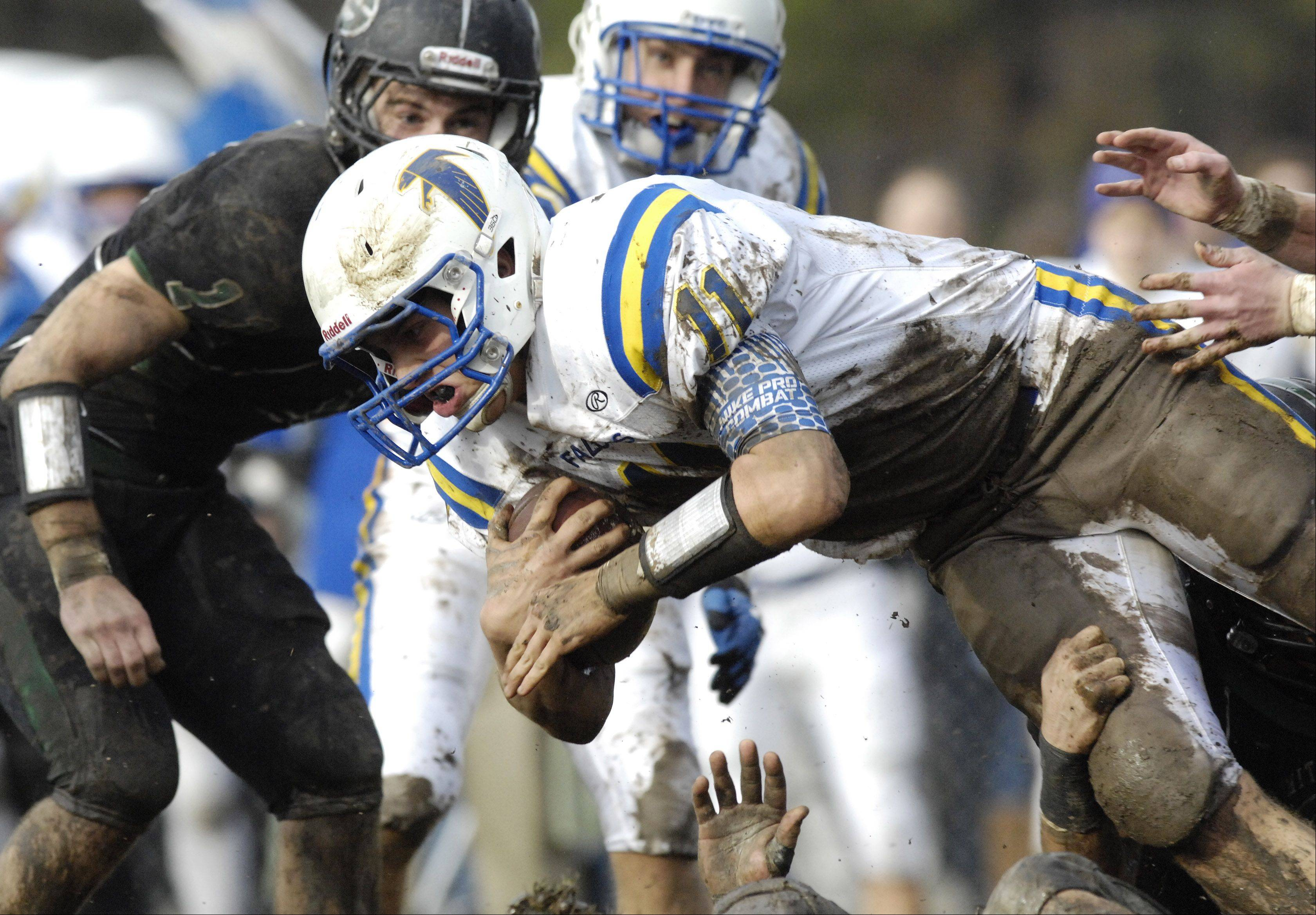 Wheaton North quarterback John Peltz dives for extra yardage during Saturday's game against Glenbard West.