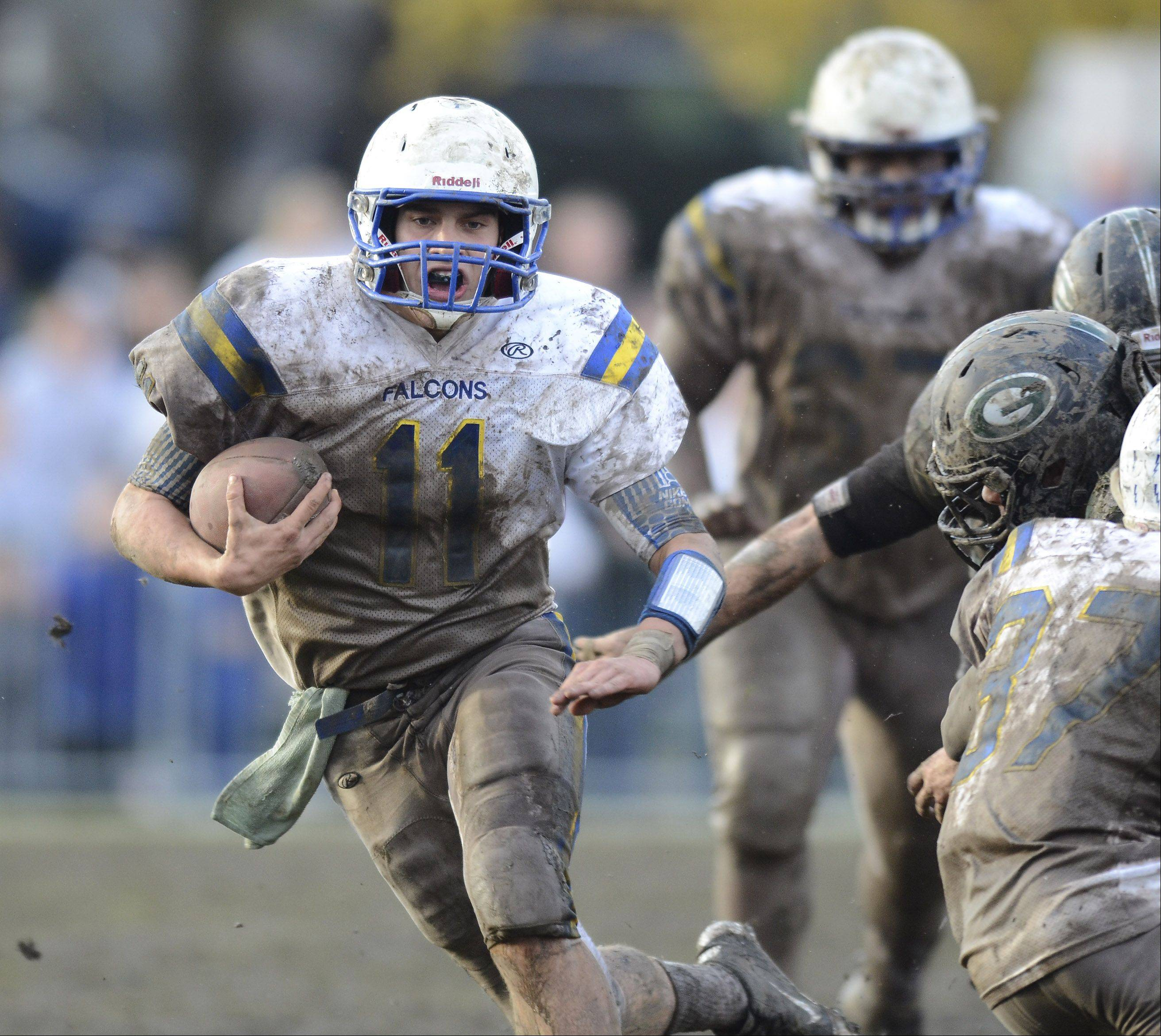 Wheaton North quarterback John Peltz carries the ball during Saturday's game against Glenbard West.