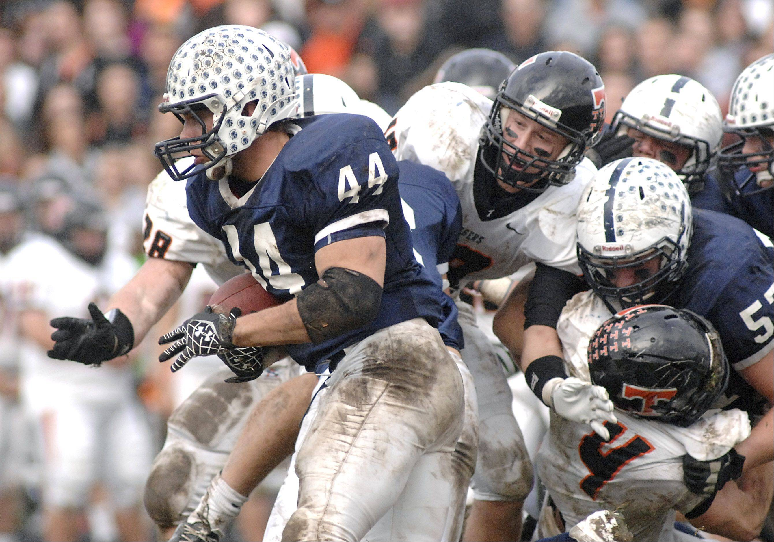 Cary-Grove's Kyle Norberg sprints past a pile up of Trojans and Crystal Lake Central Tigers in the fourth quarter.