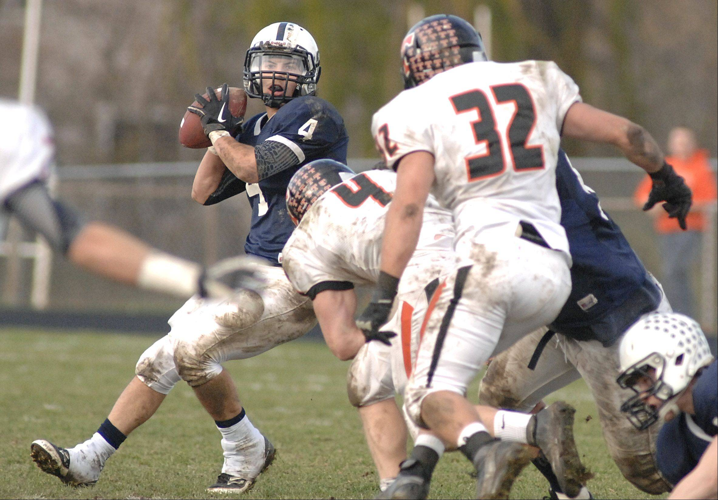 Cary-Grove's Ryan Mahoney readies to pass down the field past Crystal Lake Central in the third quarter on Saturday, November 10.