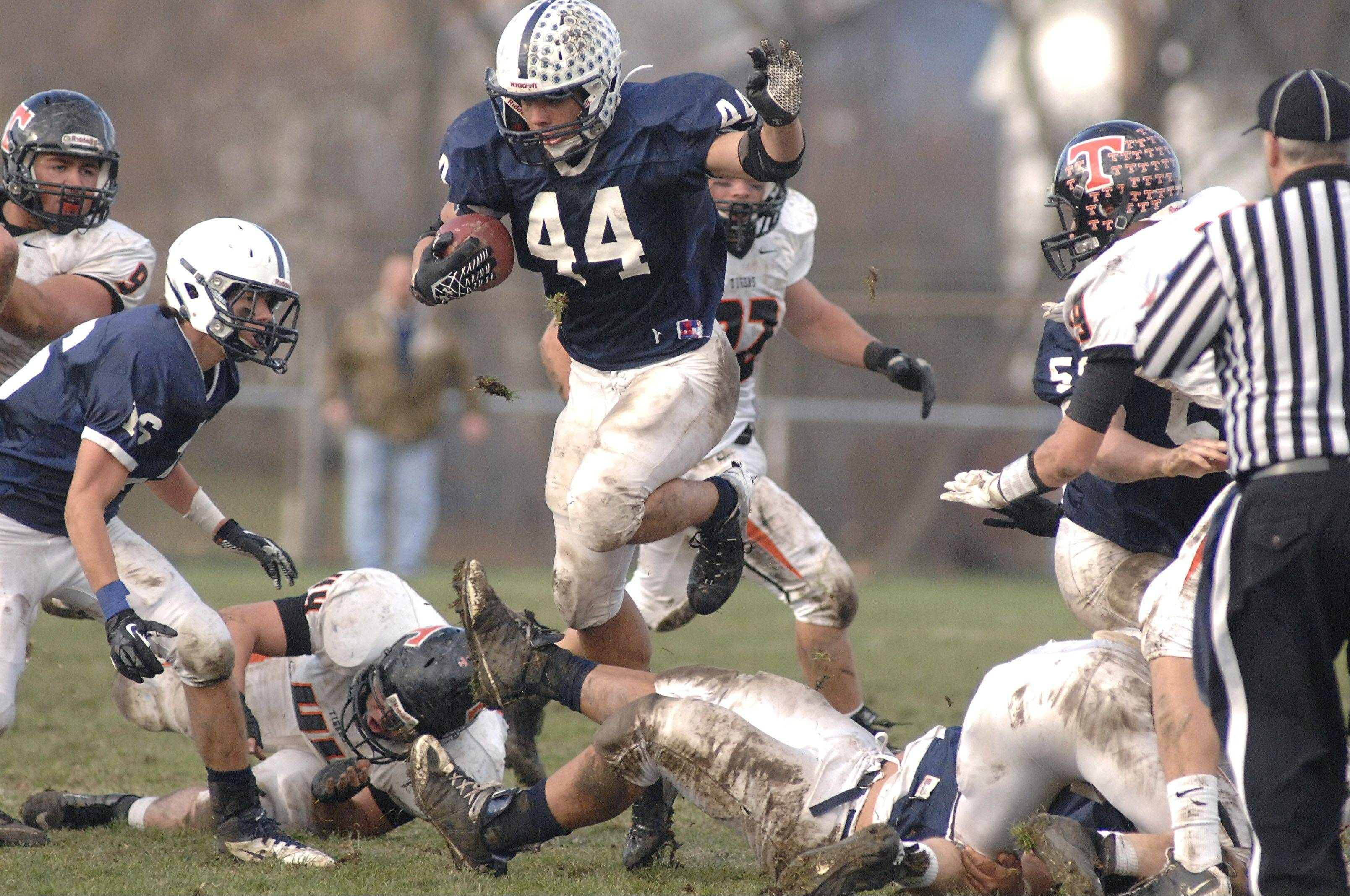 Cary-Grove's Kyle Norberg leaps over a block in the third quarter.