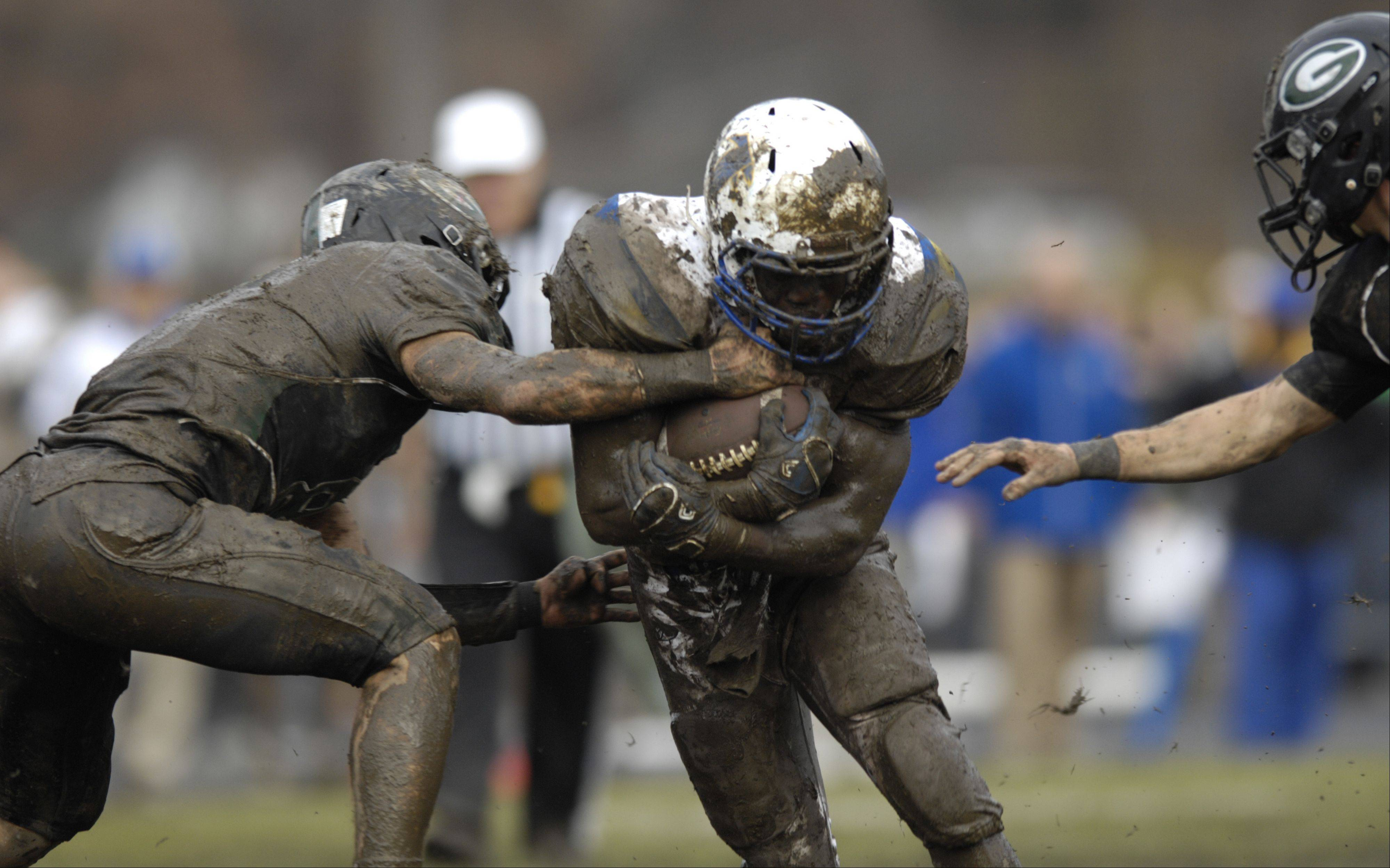 It was a mud bowl last Saturday when Glenbard West defeated Wheaton North in their third-round playoff game in Glen Ellyn. After freezing conditions this week, the IHSA approved a decision to move Saturday's 1 p.m. game between Lake Zurich and Glenbard West to nearby Glenbard South High School. The game time and date are unchanged.