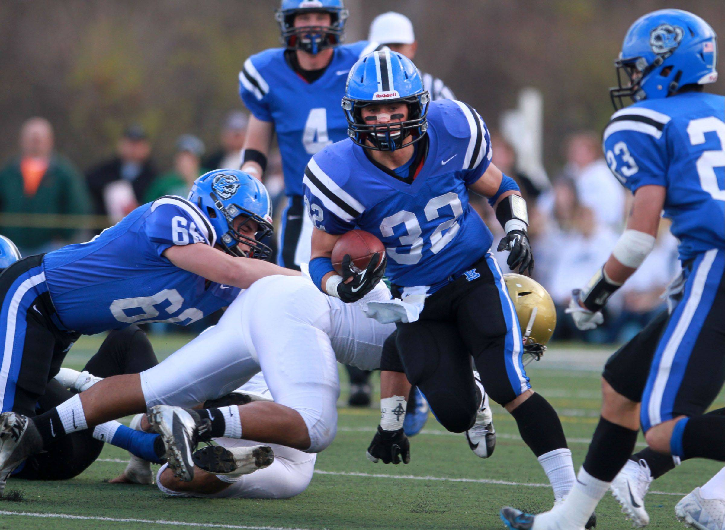 Lake Zurich running back Connor Schrader finds a hole against Rockford Boylan in last weekend's Class 7A state quarterfinal game.