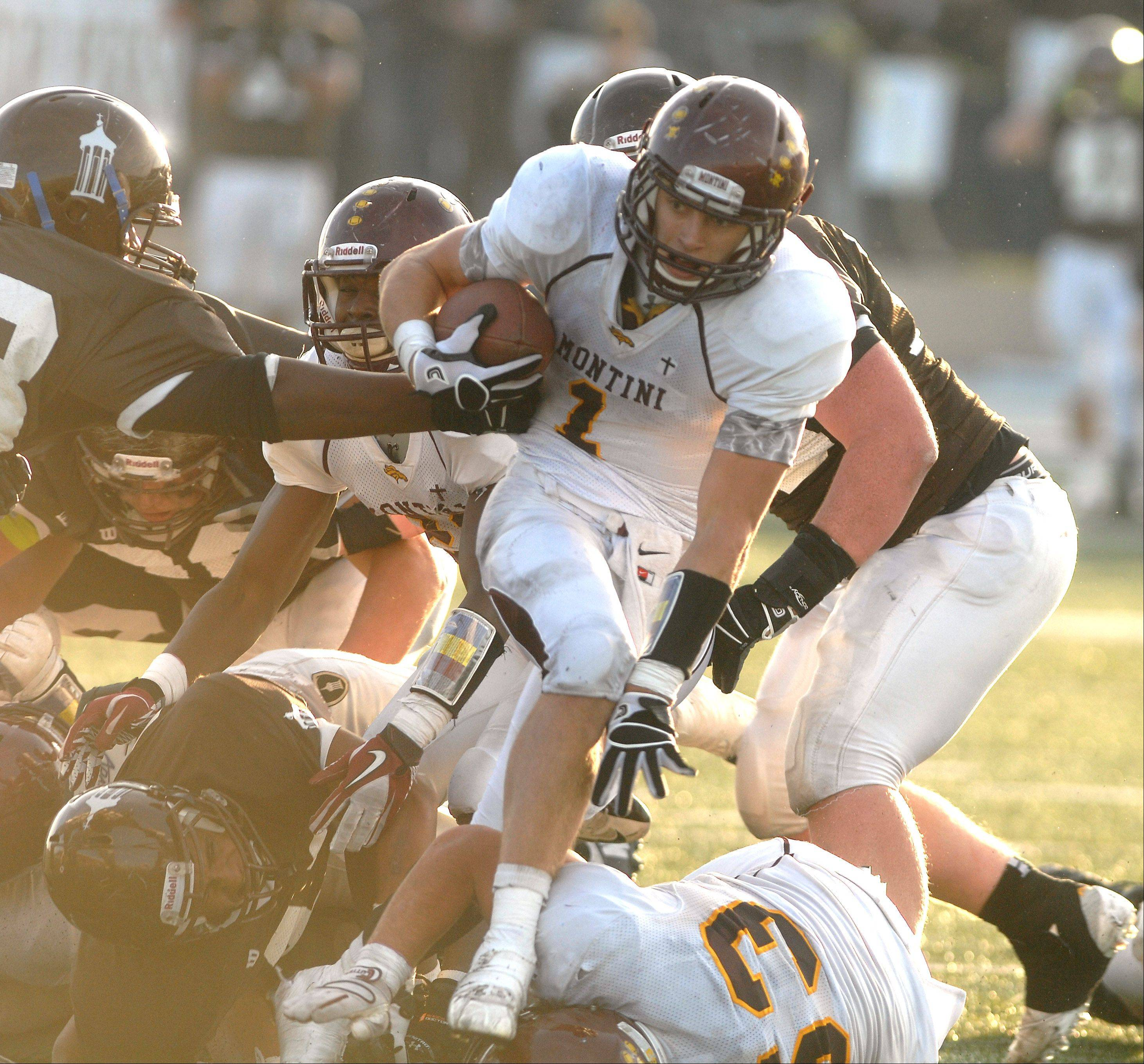 Images: Montini at Joliet Catholic in Class 5A football semifinal football action.