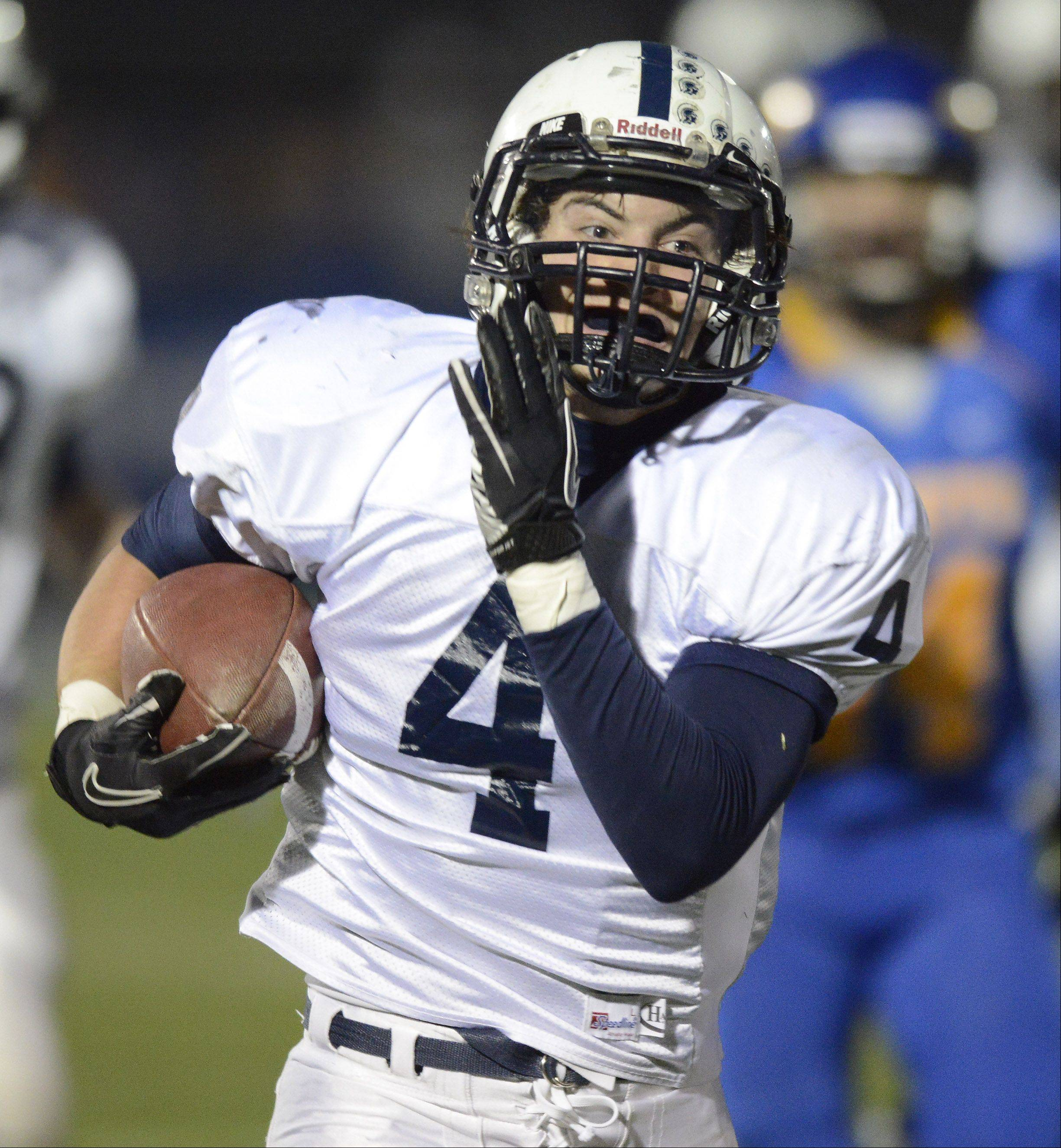 Cary-Grove running back Ryan Mahoney carries the ball against Lake Forest during Saturday's class 6A football semifinal.