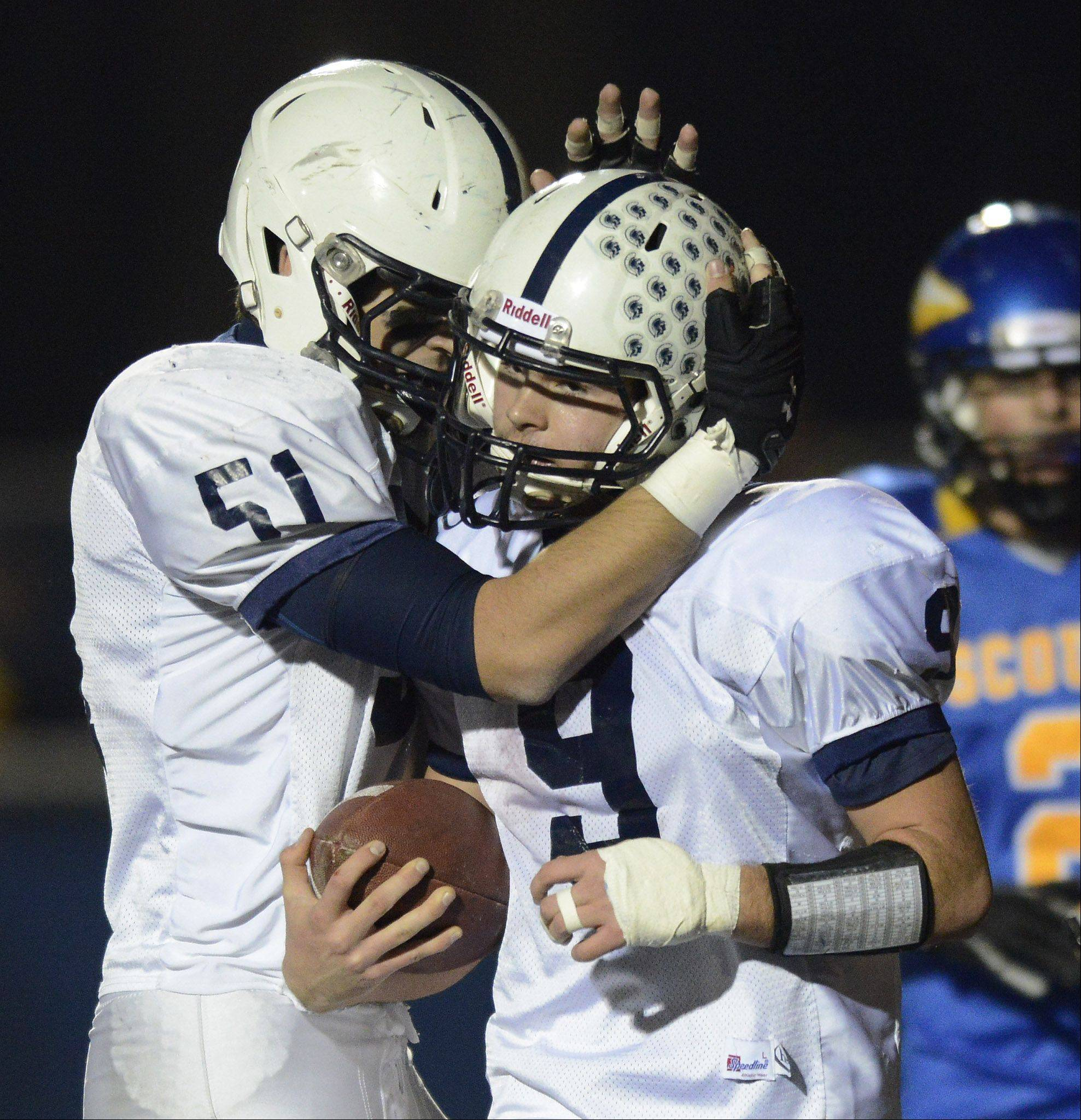 Cary-Grove's Kyle Matthiessen, left, congratulates quarterback Quinn Baker after his touchdown against Lake Forest during Saturday's class 6A football semifinal.
