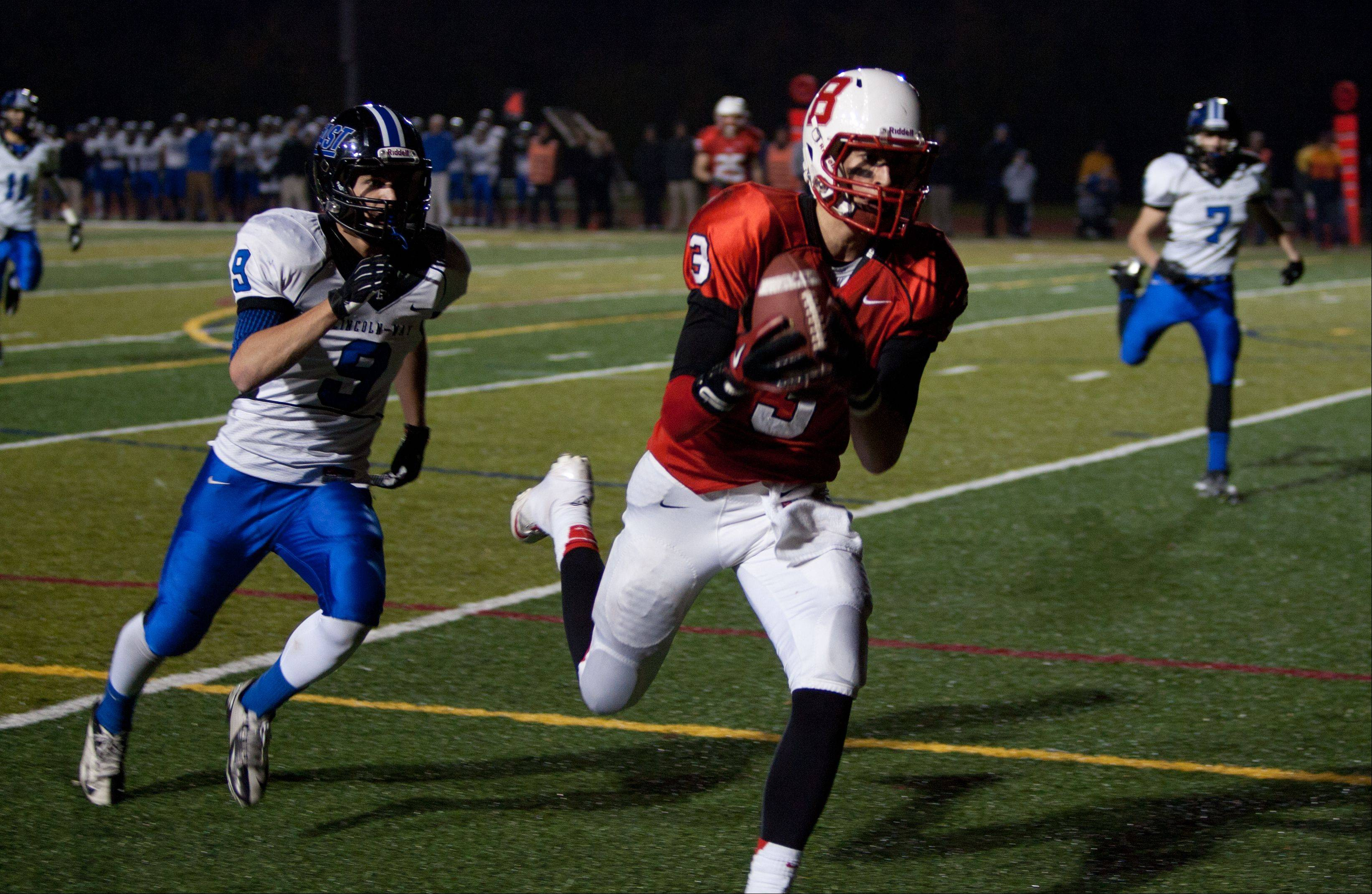 Benet's Jack Euritt (3), hauls in a fourth down, fourth quarter touchdown pass against Lincoln-Way East.