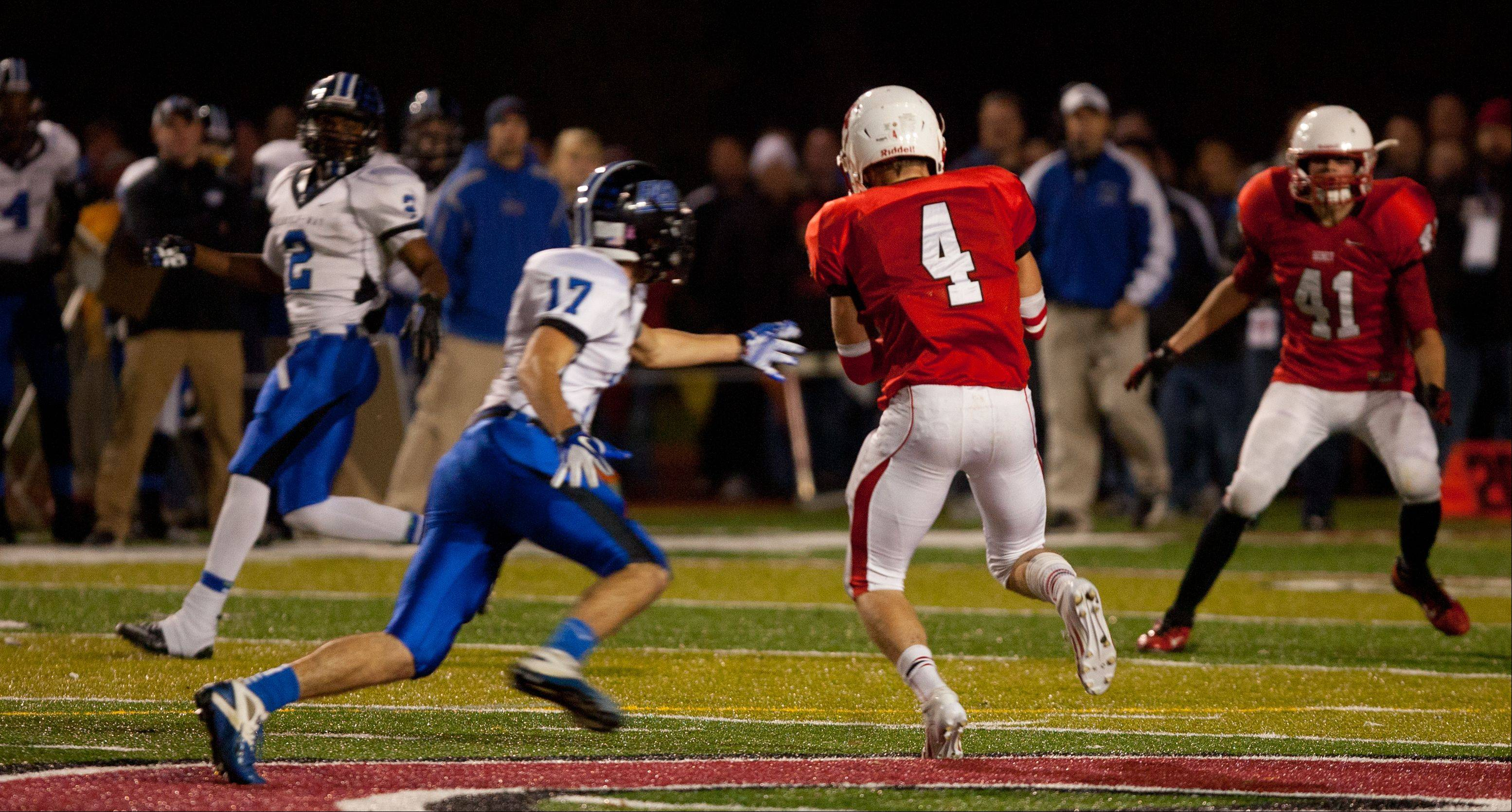 Benet's Pat Runger (4), intercepts a first half Lincoln-Way East pass during Class 7A football semifinals.