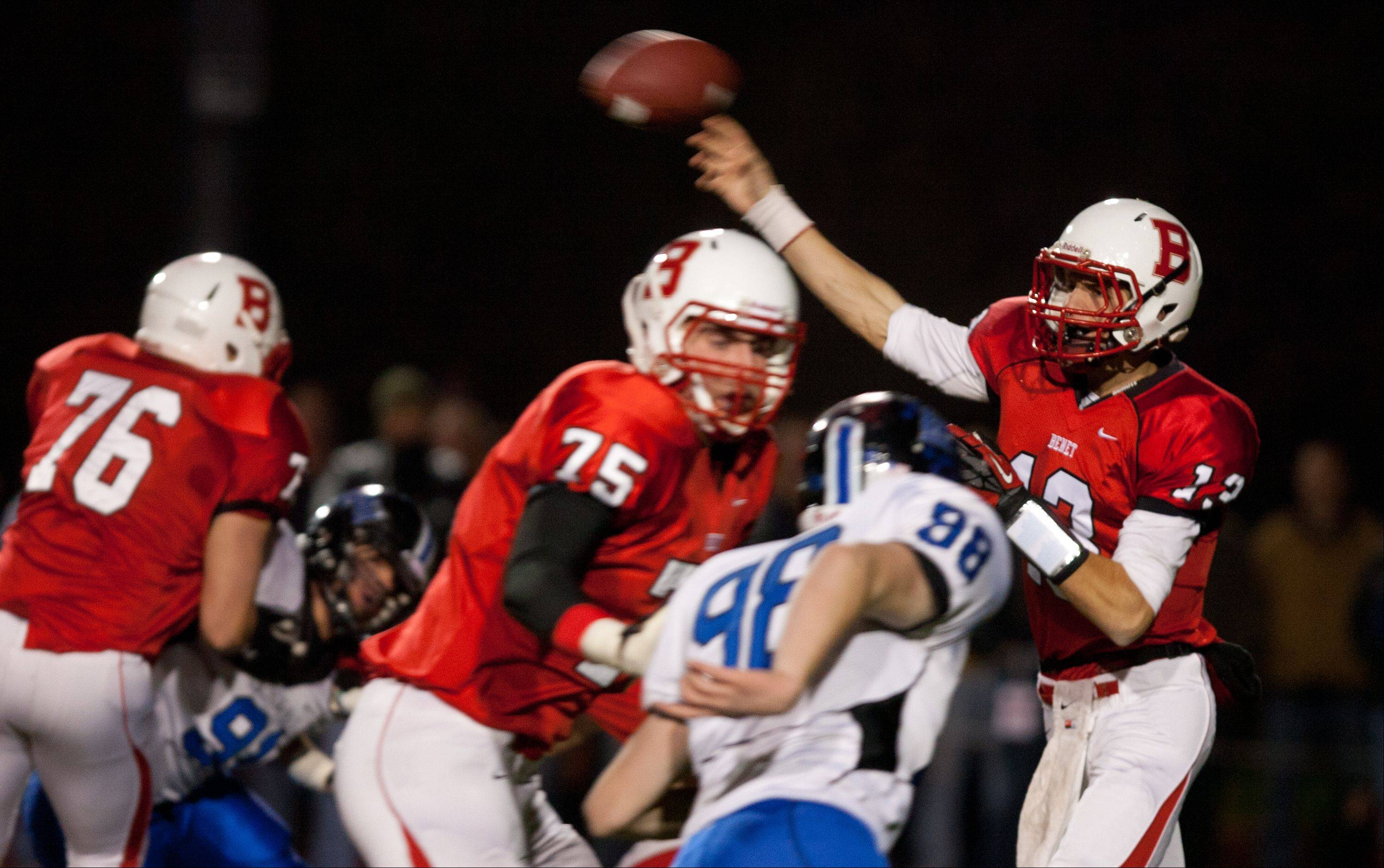 Benet quarterback Jack Beneventi passes over the middle against Lincoln-Way East during Class 7A football semifinals at Benedictine.
