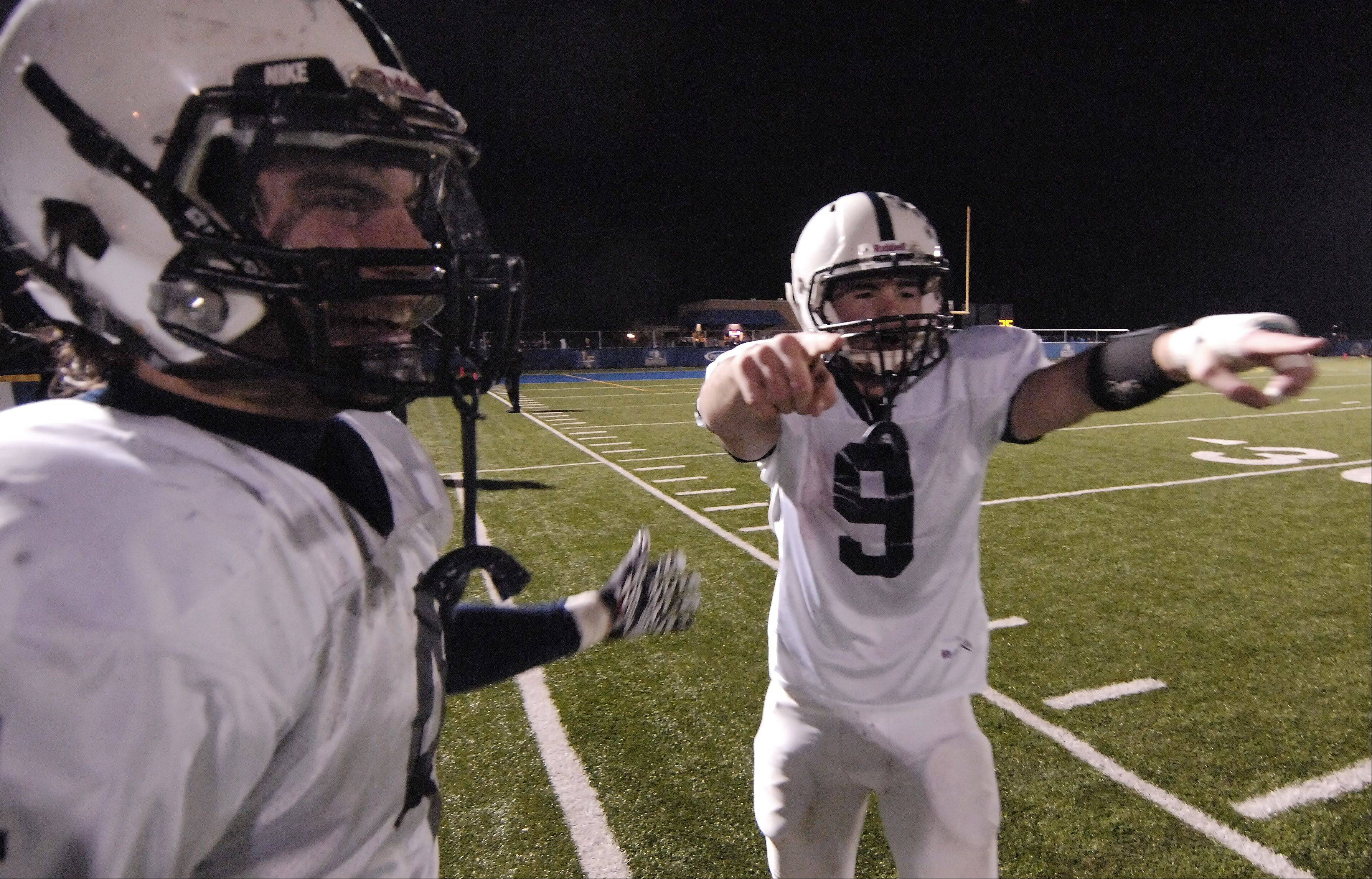 Cary-Grove running back Ryan Mahoney, left, and quarterback Quinn Baker celebrate the Trojans' 42-14 victory over Lake Forest during Saturday's Class 6A football semifinal in Lake Forest.