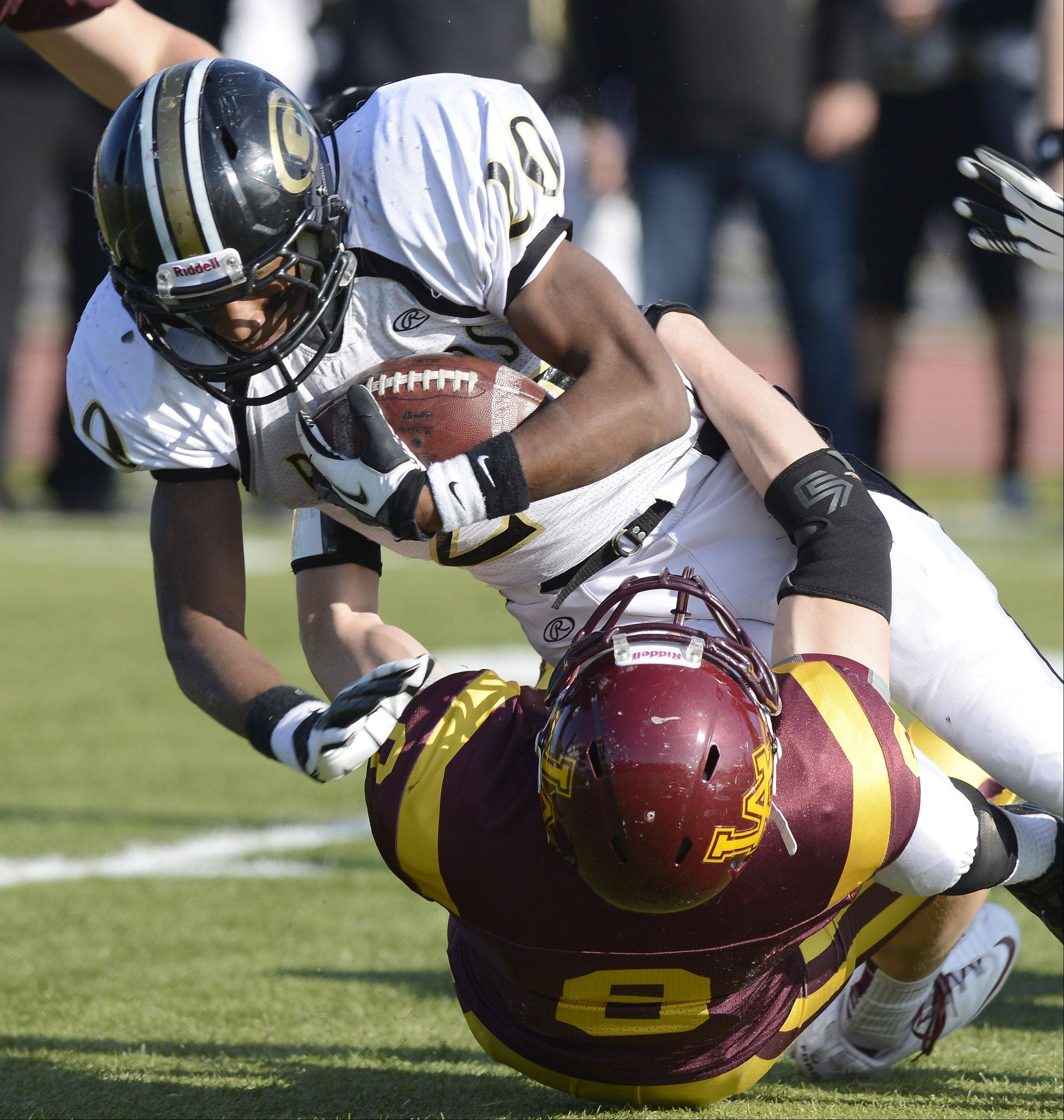 Glenbard North's Justin Jackson gets tackled by Loyola Academy's Luke Ford during Saturday's class 8A football playoff semifinal.