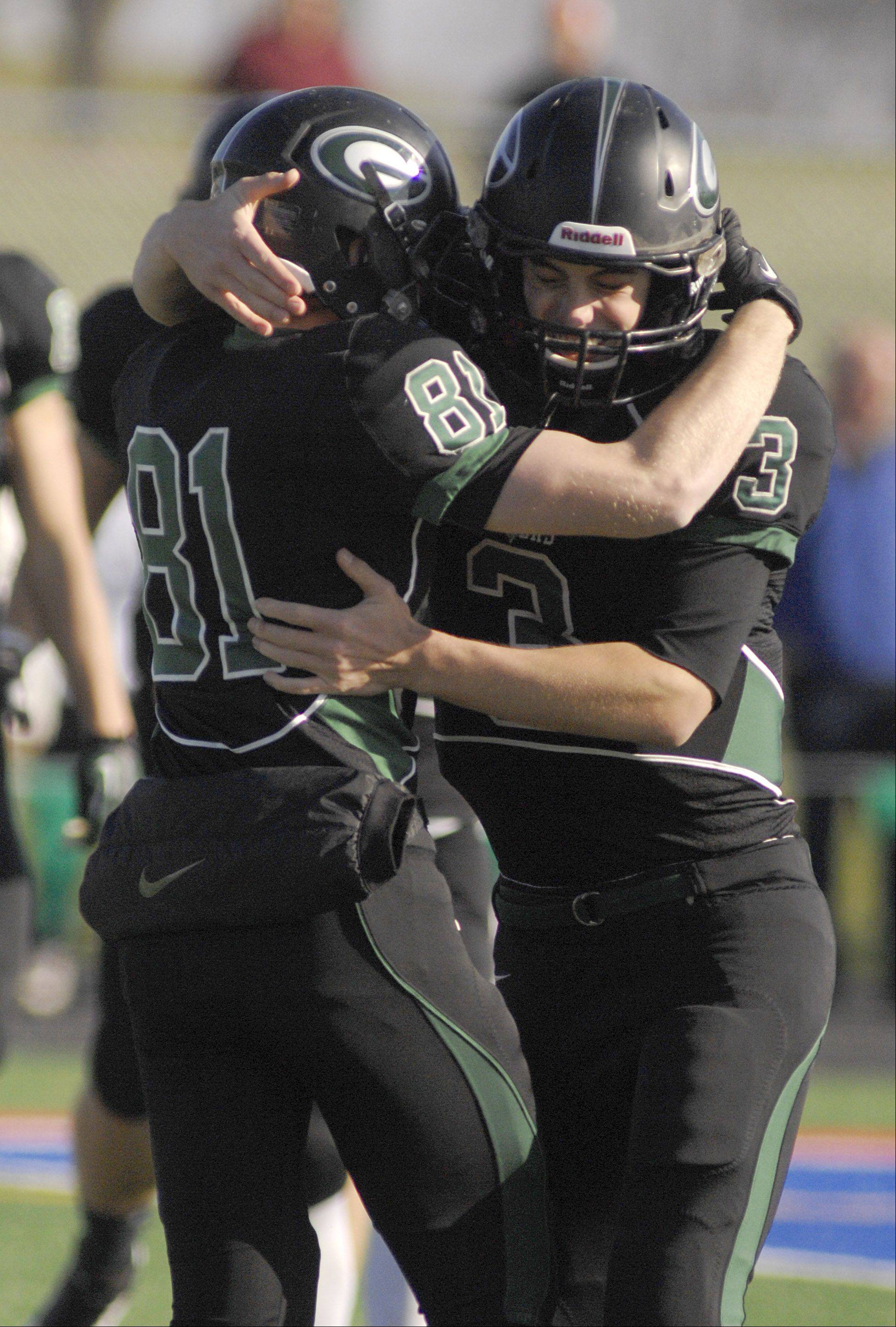 Glenbard West's Nate Hokenson (81) gets congratulated by teammate Henry Haeffner after Hokenson scored the first touchdown of the 7A semi finals game in first seconds of the first quarter on Saturday, Nov. 17.