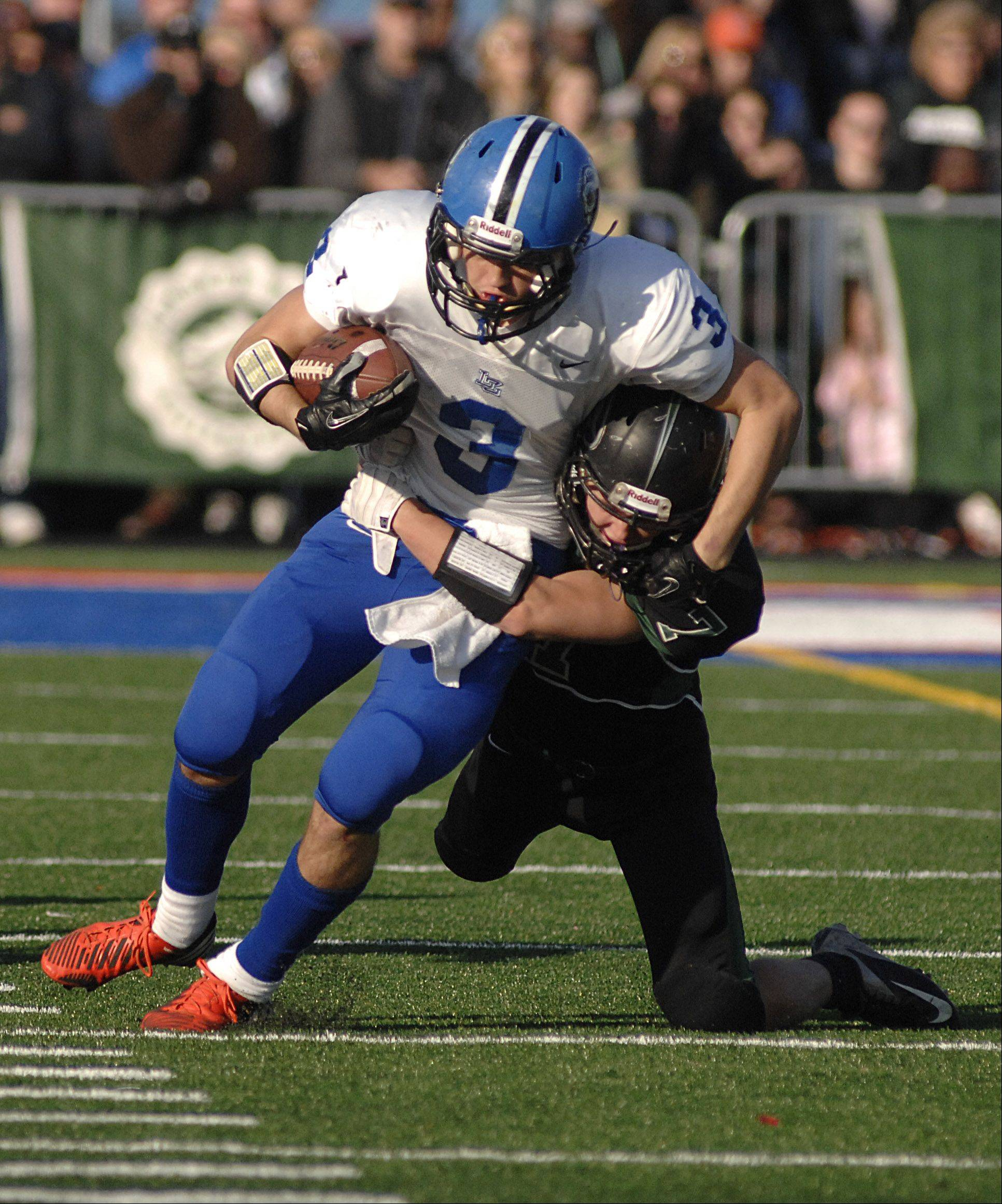 Glenbard West's Charlie Sweeney clamps on to Lake Zurich's Steven Walcott in the second quarter on Saturday, Nov. 17.