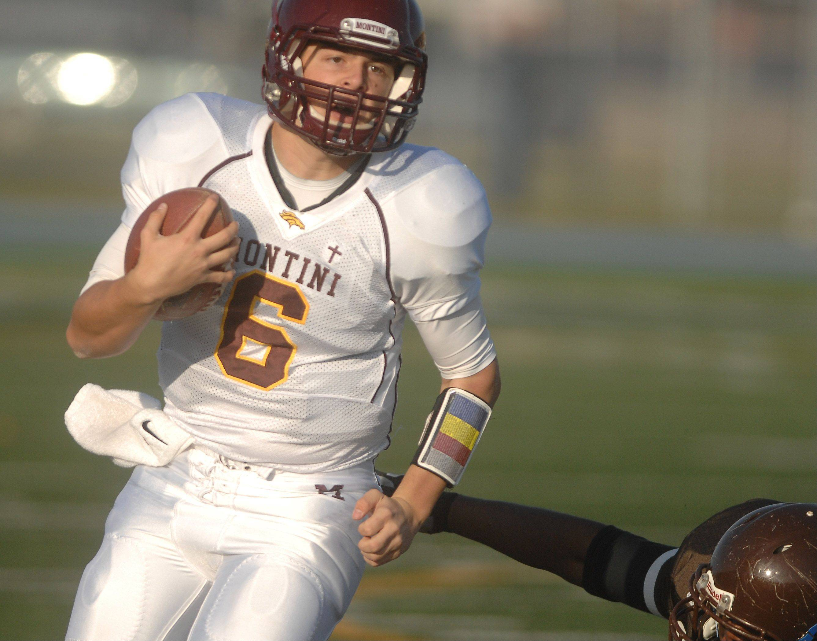 Alexander Wills of Montini moves the ball during the Montini at Joliet Catholic Class 5A football semifinal action Saturday.