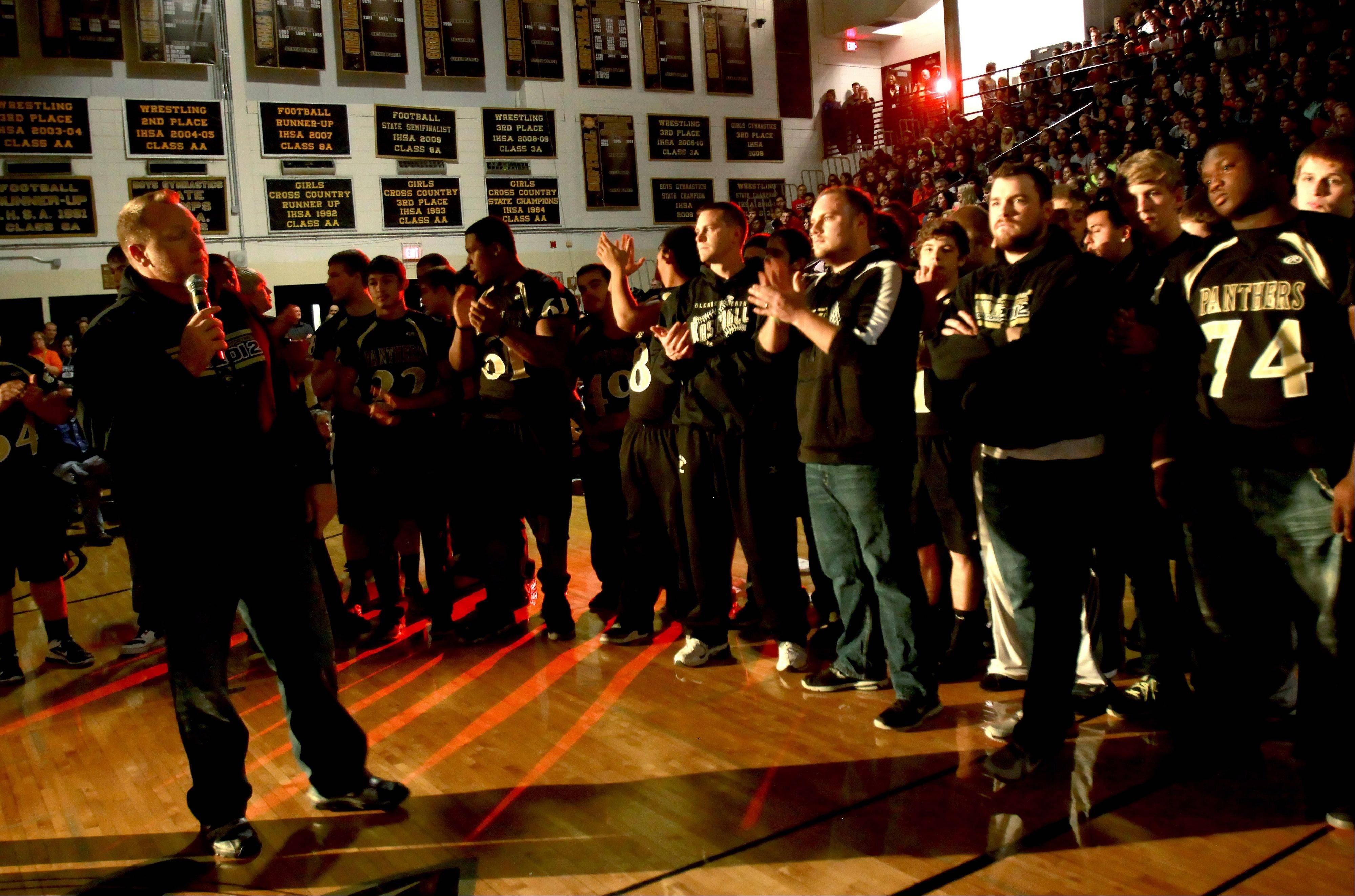 Glenbard North head football coach Ryan Wilkens, left, speaks at a pep rally Tuesday at the Carol Stream school. The team will play Mt. Carmel Saturday in Champaign for the Class 8A State Championship.