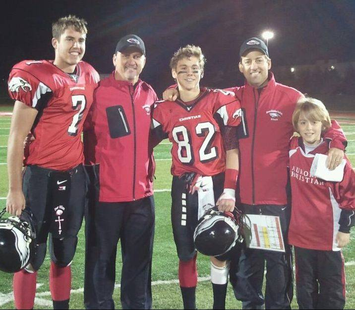 Brothers Don and David Beebe run Aurora Christian's offense and defense, respectively. They are pictured here after a win over Winnebago in the quarterfinals: from left, nephew and Eagles quarterback Ryan McQuade, head coach Don Beebe, Don's son Chad Beebe, defensive coordinator David Beebe and David's son, Caleb.