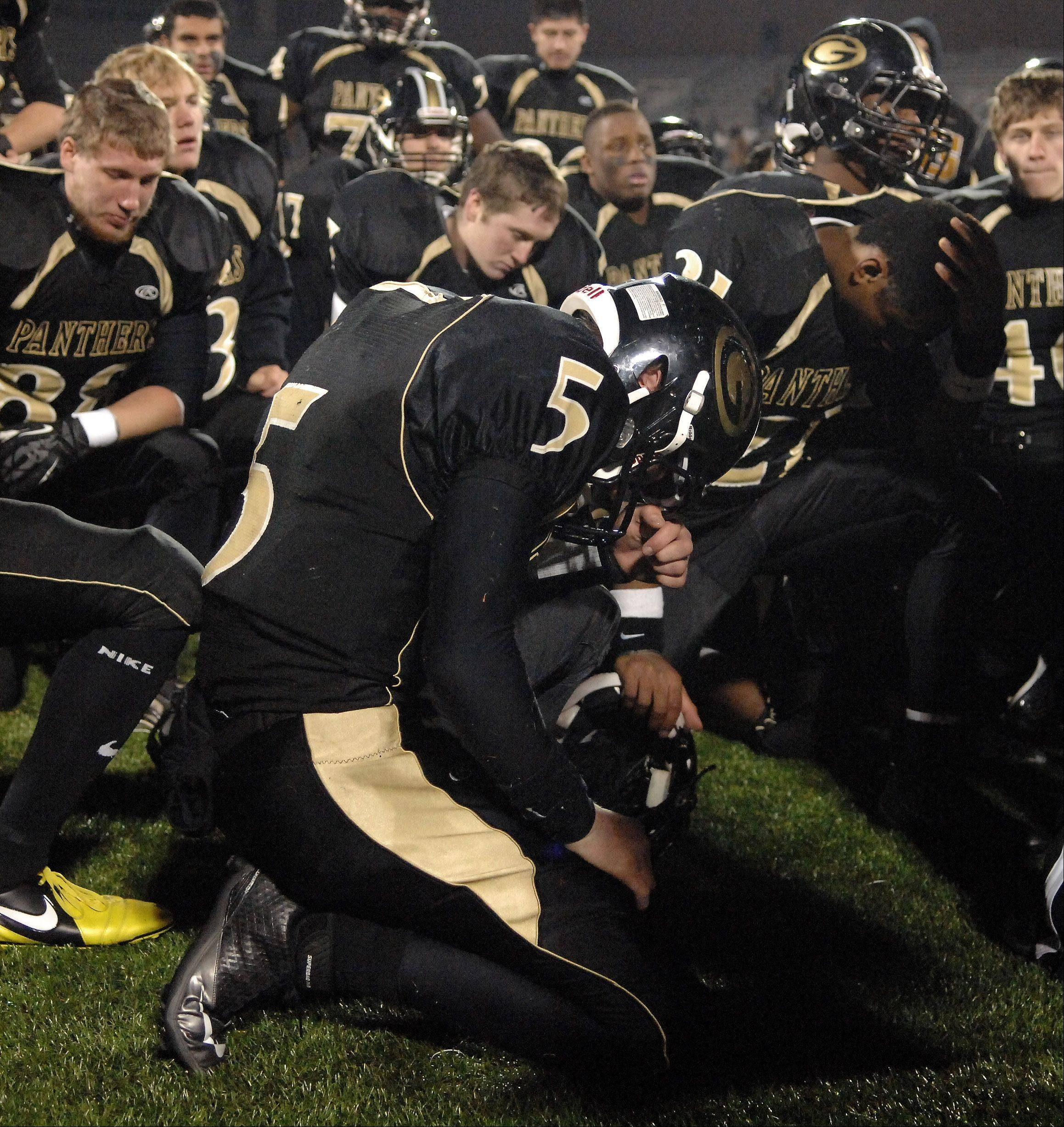Glenbard North's Bran Murphy bows his head following the Panthers loss to Mt. Carmel during Saturday's Class 8A state title game at Memorial Stadium in Champaign.